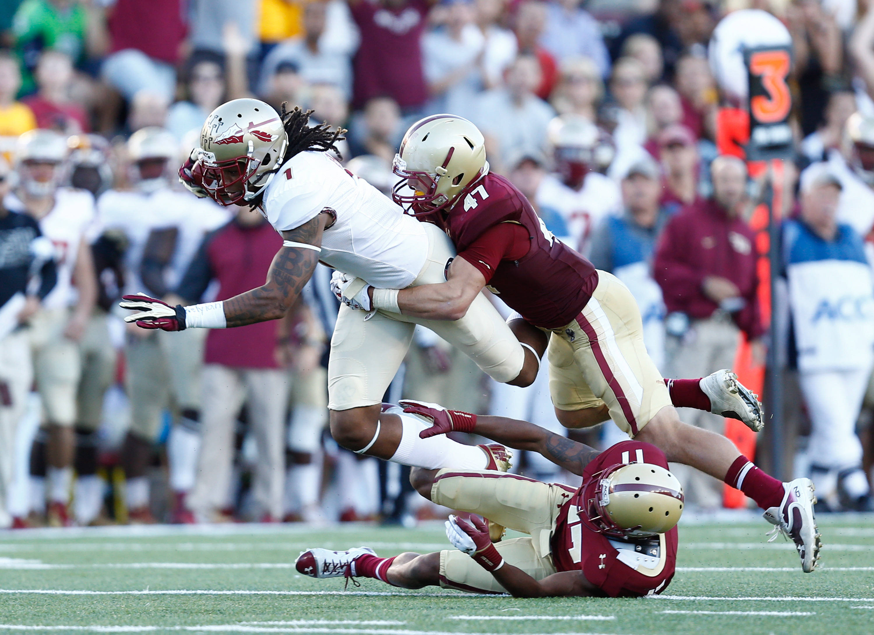 Kelvin Benjamin (1) is tackled by Boston College Eagles defensive back Bryce Jones (17) and defensive back Spenser Rositano (47). Mandatory Credit: Mark L. Baer-USA TODAY Sports