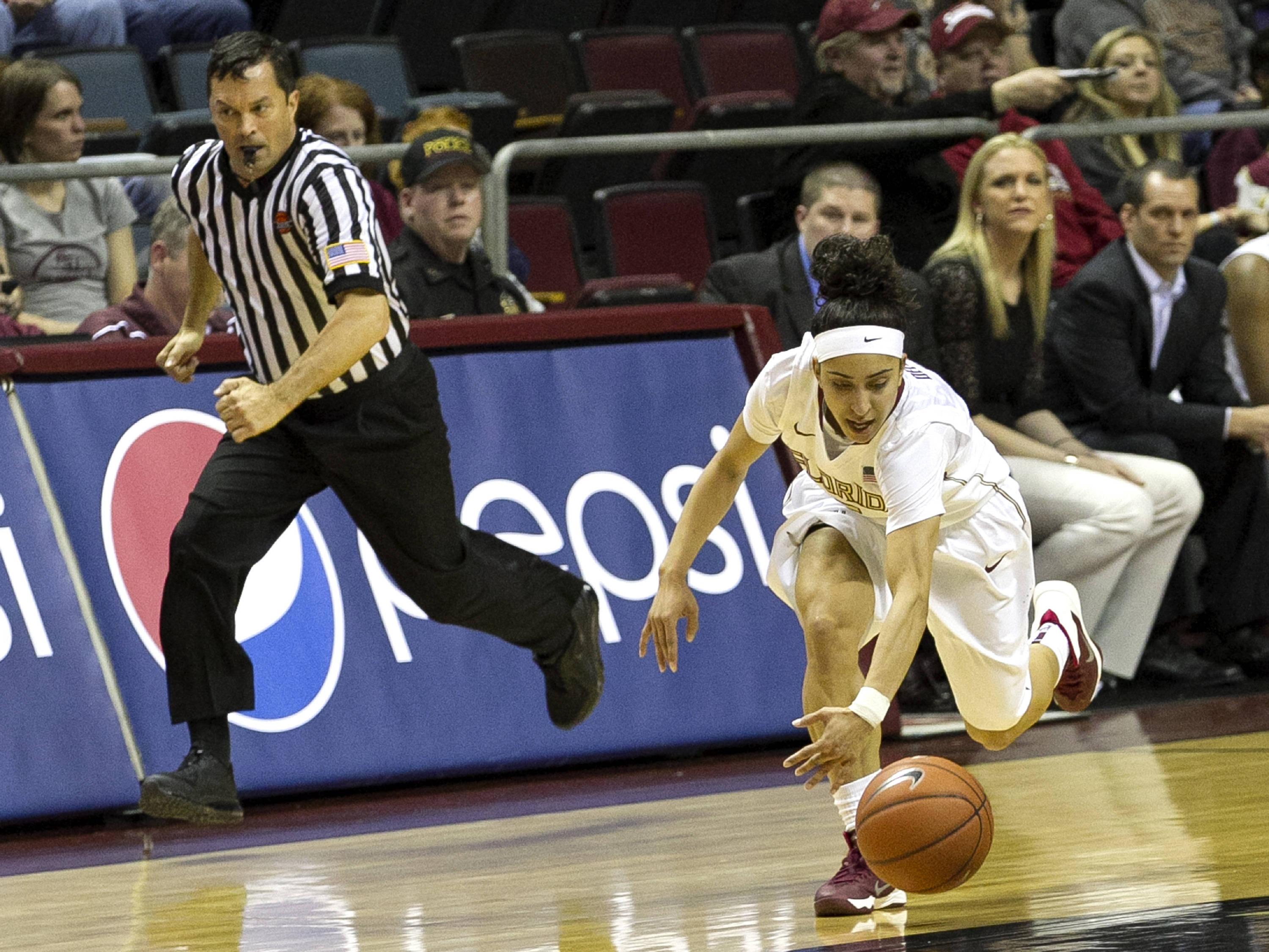Cheetah Delgado (5) goes low to pick up a steal, FSU vs Notre Dame, 2-06-14, (Photo's by Steve Musco)