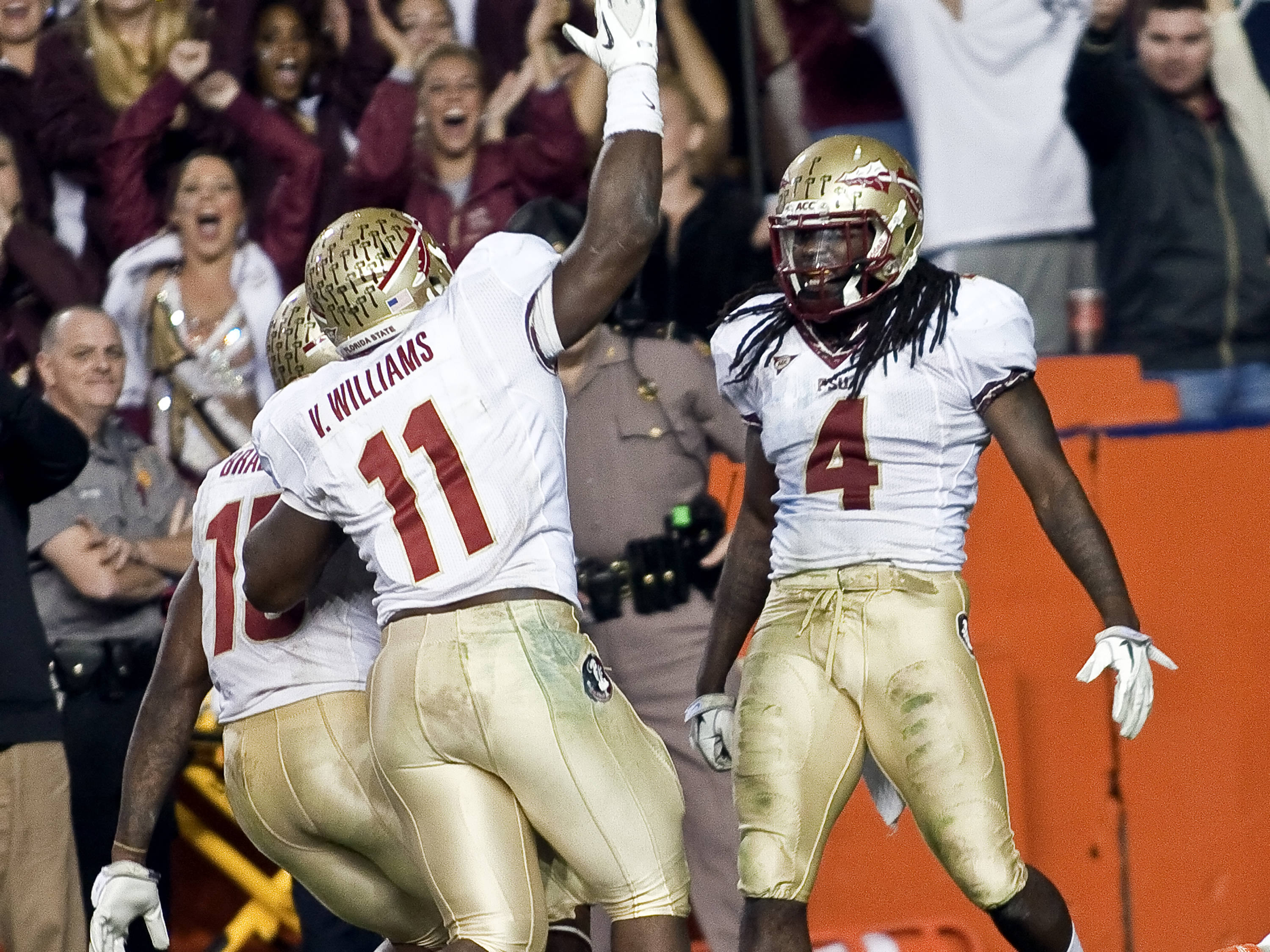 "Vince Williams (11) celebrating Terrance Parks (4) ""pick-six"", FSU vs Florida, 11/26/2011"