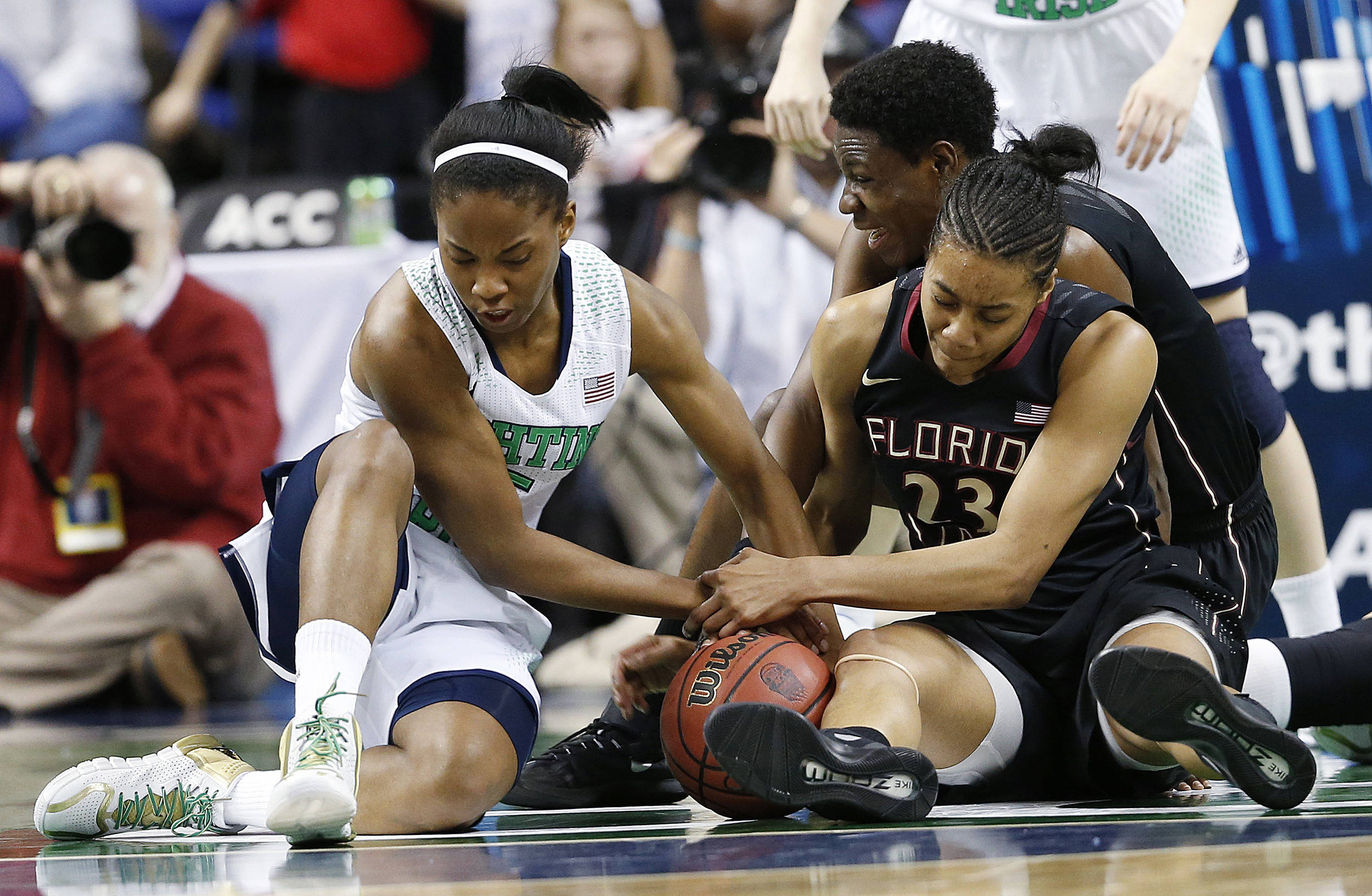 Mar 7, 2014; Greensboro, NC, USA; Notre Dame Fighting Irish guard Lindsay Allen (15) battles Seminoles player Ivey Slaughter for a loose ball. Ellen Ozier-USA TODAY Sports
