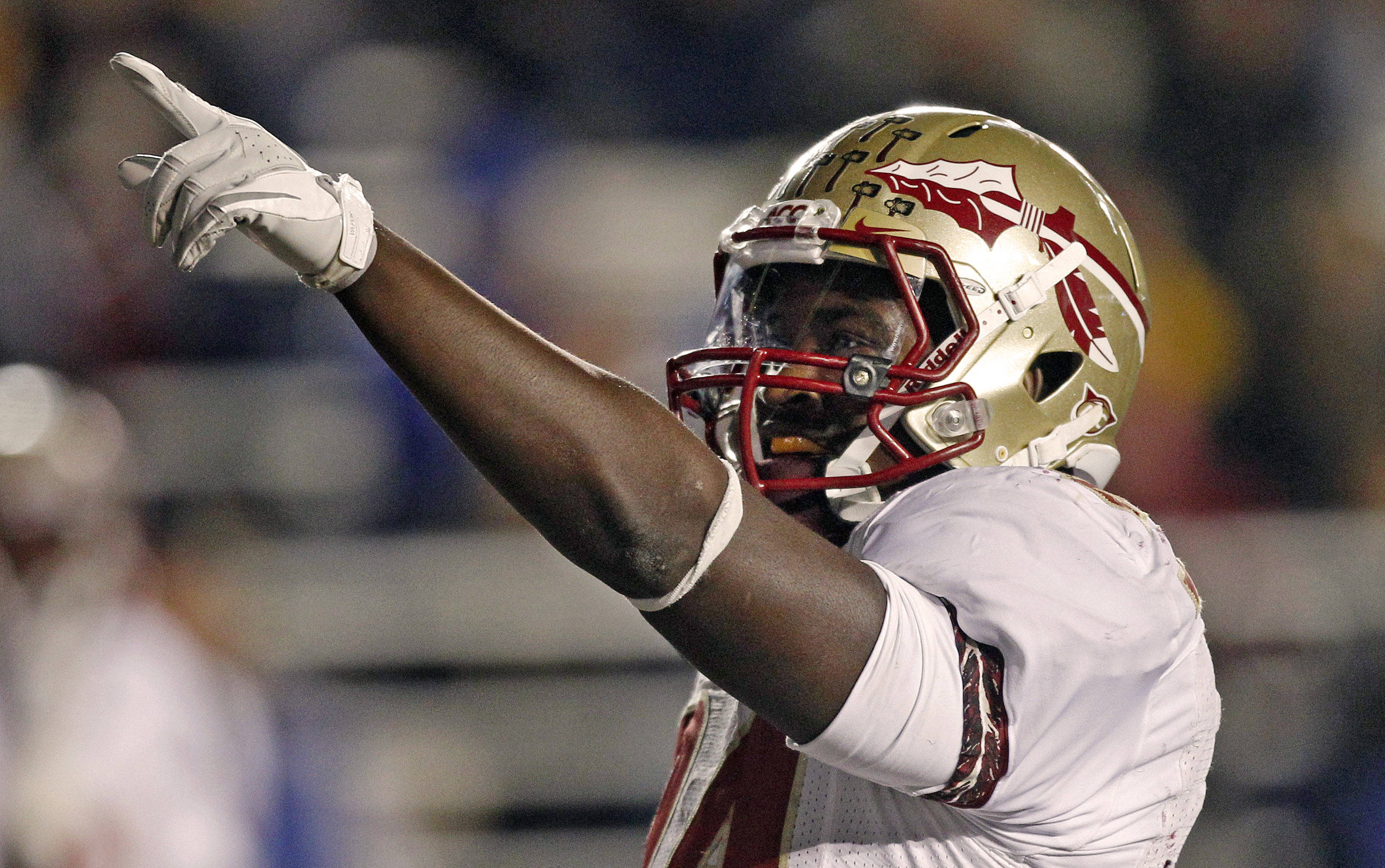 Florida State running back Lonnie Pryor points to fans after scoring against Boston College during the second half. (AP Photo/Charles Krupa)