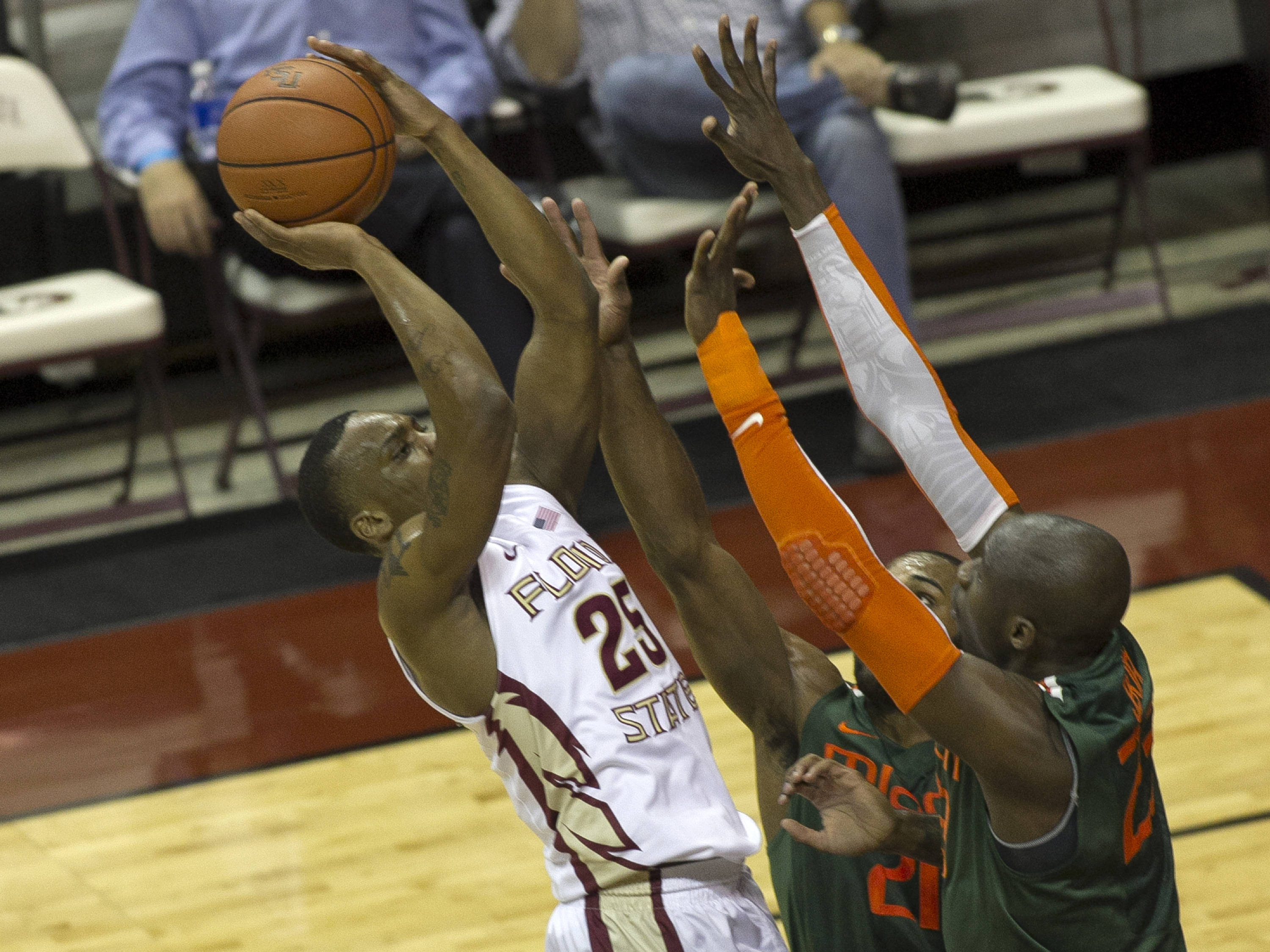Aaron Thomas (25) shooting over pressure, FSU vs Miami, 2-10-14, (Photo's by Steve Musco)