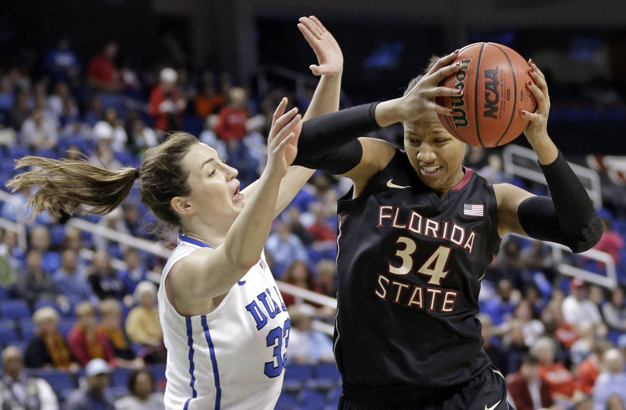 Florida State's Chelsea Davis (34) drives on Duke's Haley Peters (33). (AP Photo/Chuck Burton)
