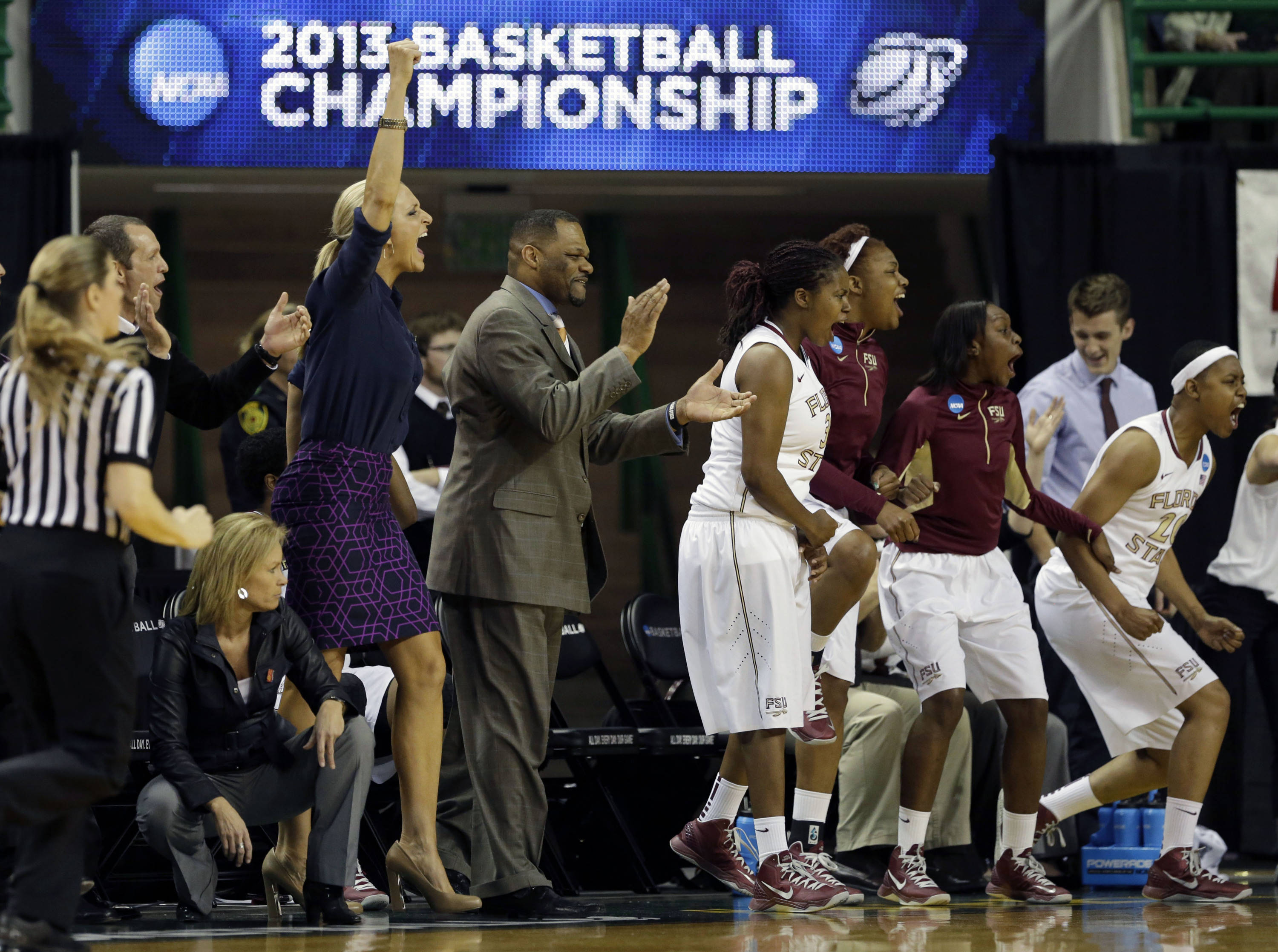 The Florida State bench celebrates a score late in the second half. (AP Photo/Tony Gutierrez)