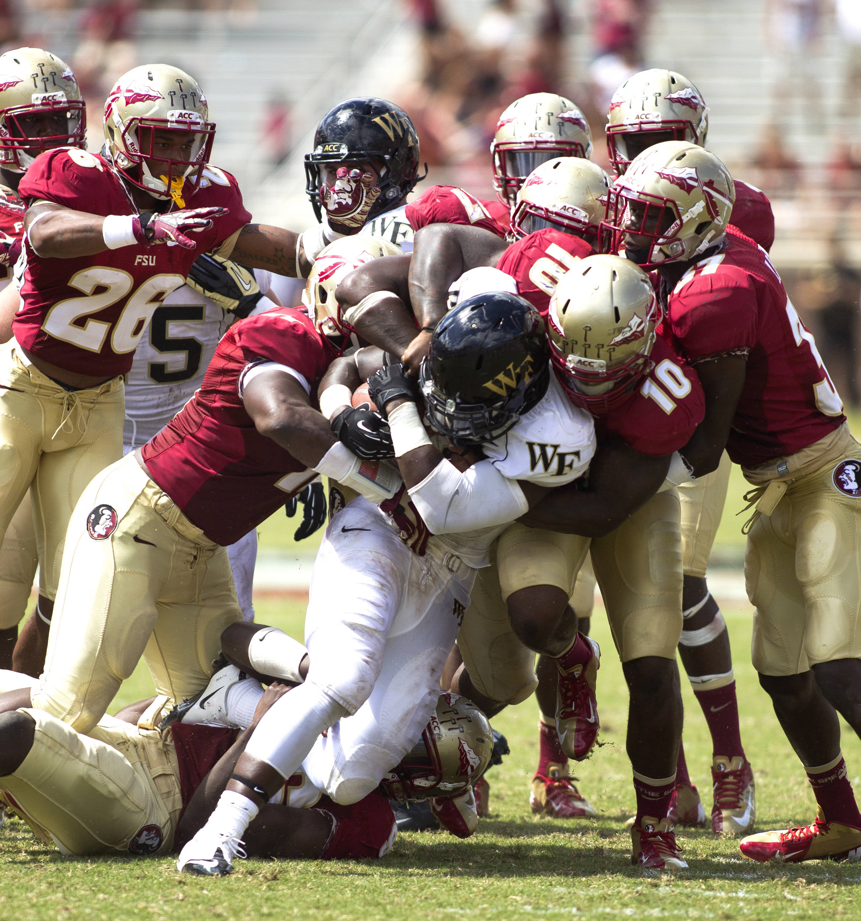 Team defensive stop, FSU vs Wake Forest, 9/15/12 (Photo by Steve Musco)