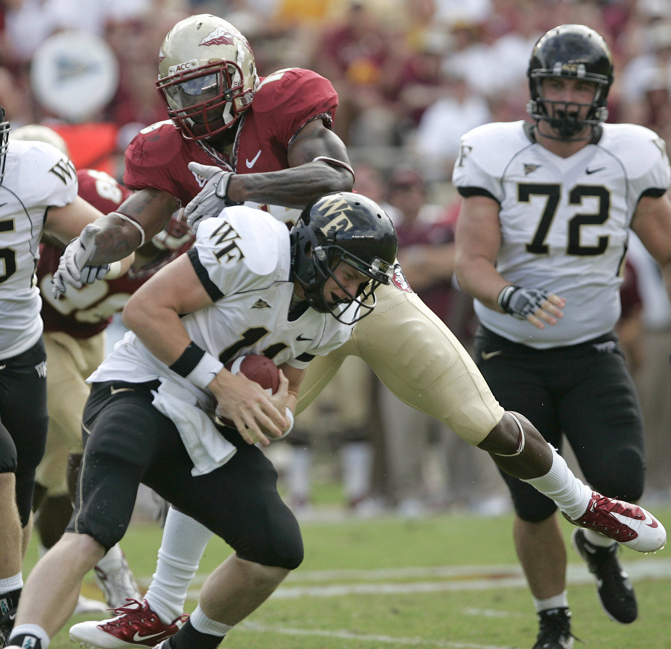 Wake Forest's Tanner Price, foreground, tries to avoid the tackle of Florida State's Nigel Bradham in the second quarter of an NCAA college football game on Saturday, Sept. 25, 2010, in Tallahassee, Fla. (AP Photo/Steve Cannon)