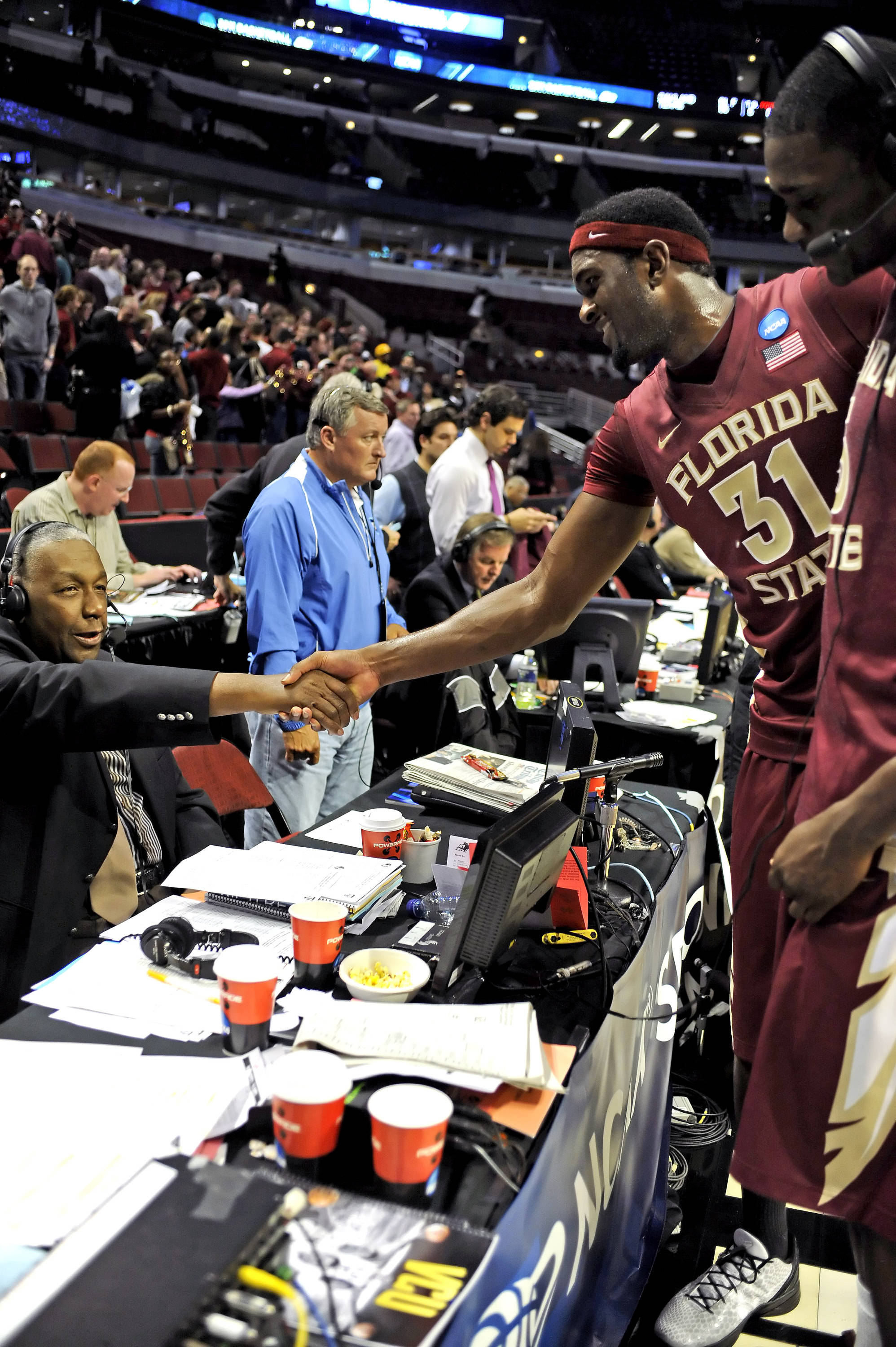 Chris Singleton shakes John Thompson's hand after doing a post game interview