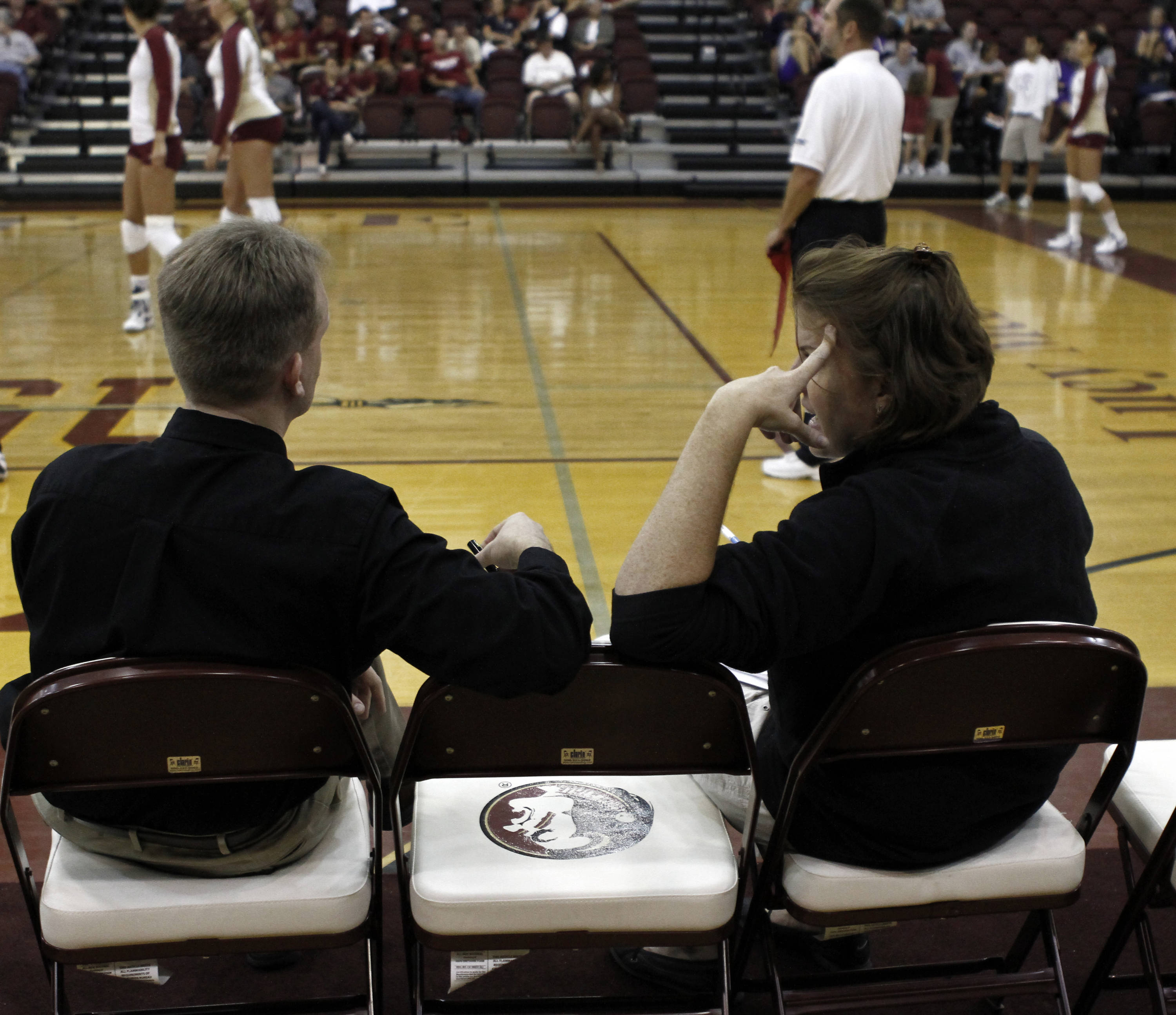 Head Coach Chris Poole and  Associate Head Coach Holly Watts