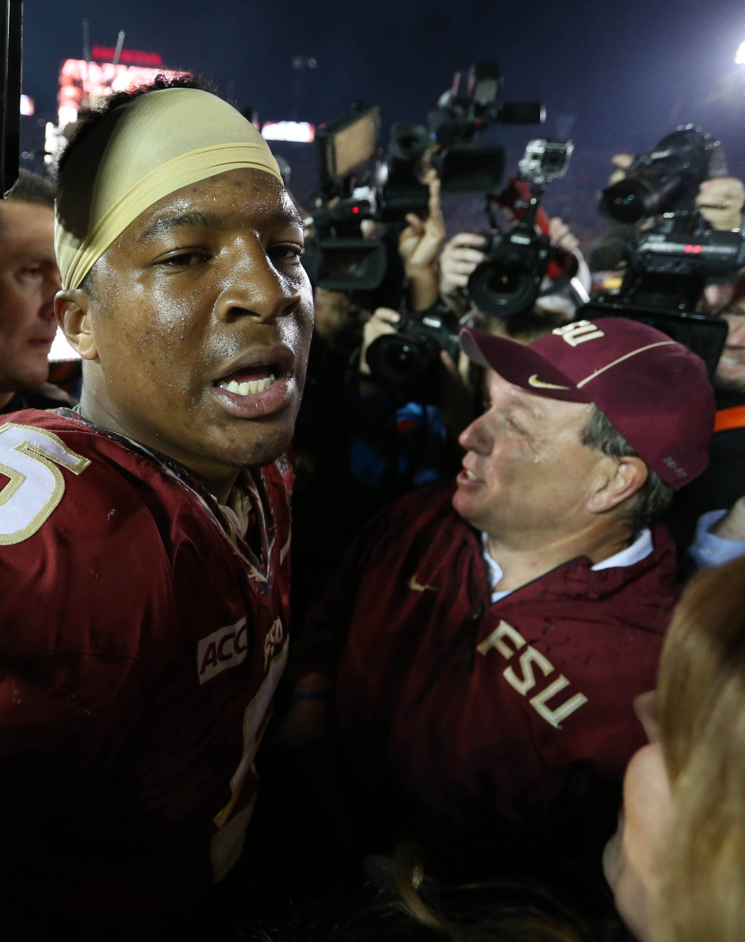 Jan 6, 2014; Pasadena, CA, USA; Florida State Seminoles head coach Jimbo Fisher (right) celebrates with Jameis Winston (5) after defeating the Auburn Tigers 34-31 in the 2014 BCS National Championship game at the Rose Bowl.  Mandatory Credit: Matthew Emmons-USA TODAY Sports