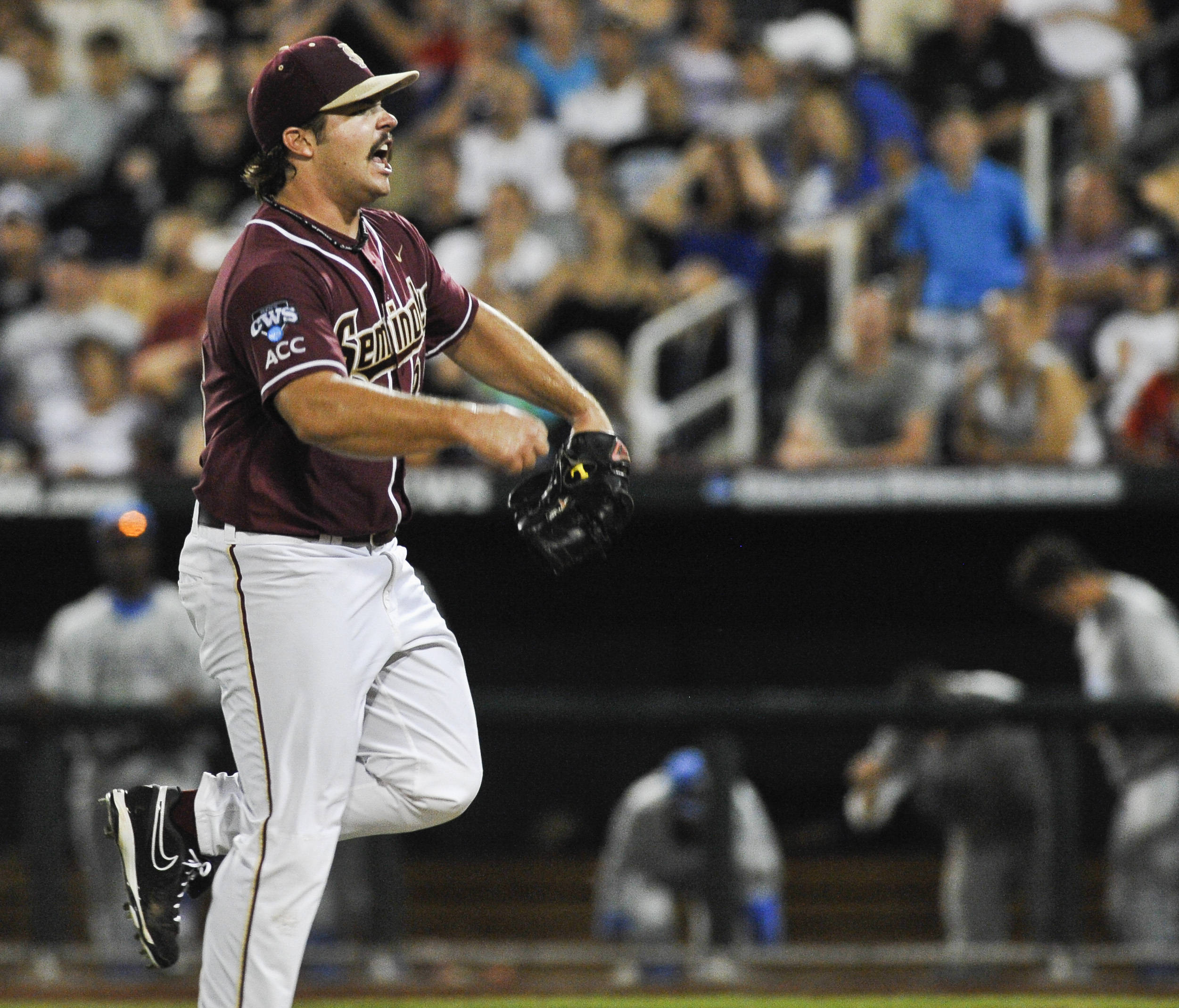 Florida State pitcher Scott Sitz celebrates after striking out UCLA's Pat Valaika and getting out of a bases-loaded situation, in the sixth inning. (AP Photo/Eric Francis)