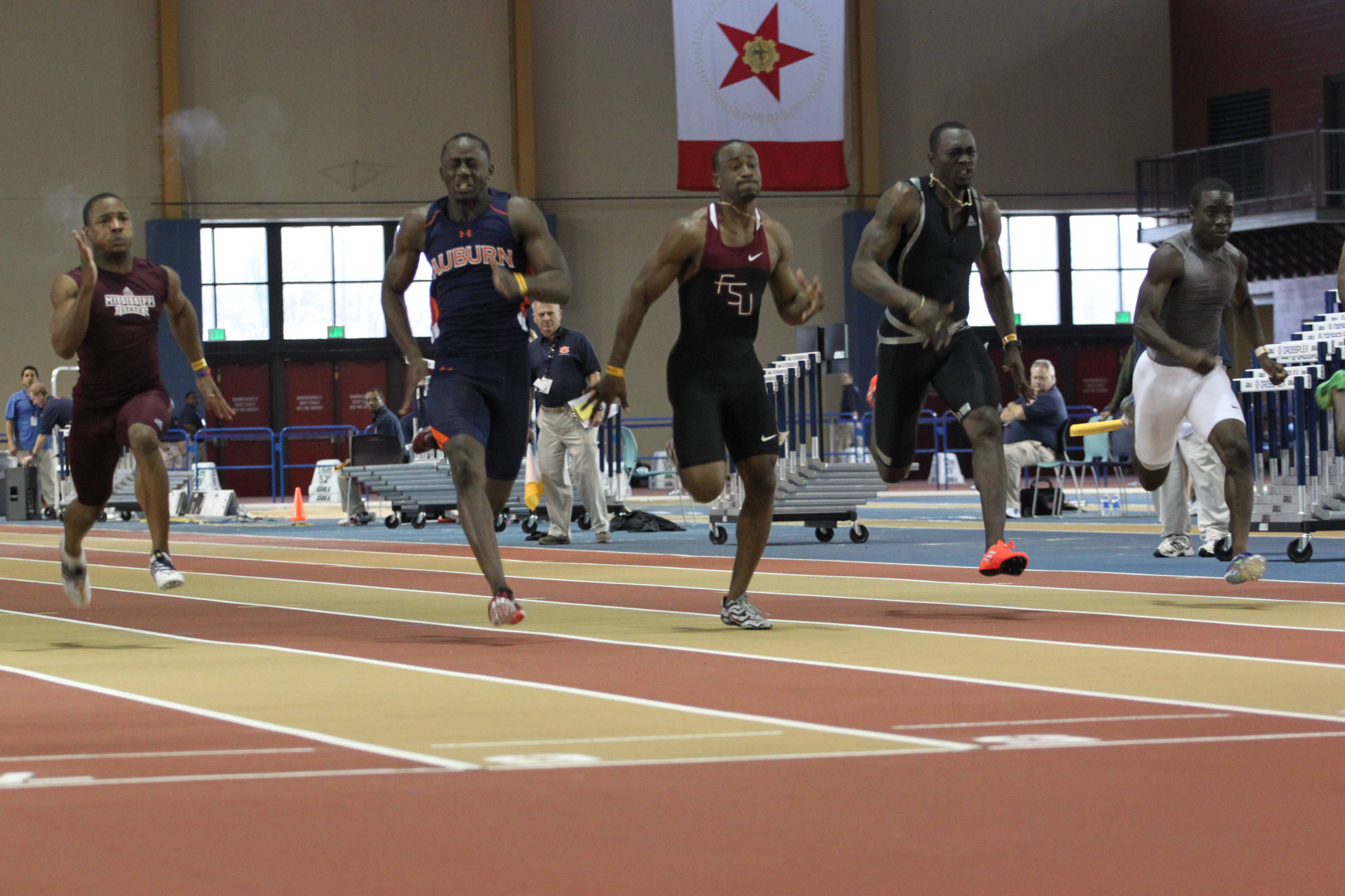 Kemar Hyman (center) battles Auburn's Harry Adams to the finish in the 60m dash finals. Hyman posted an NCAA Indoor automatic time (6.56), which is the second-fastest in the world in 2012.