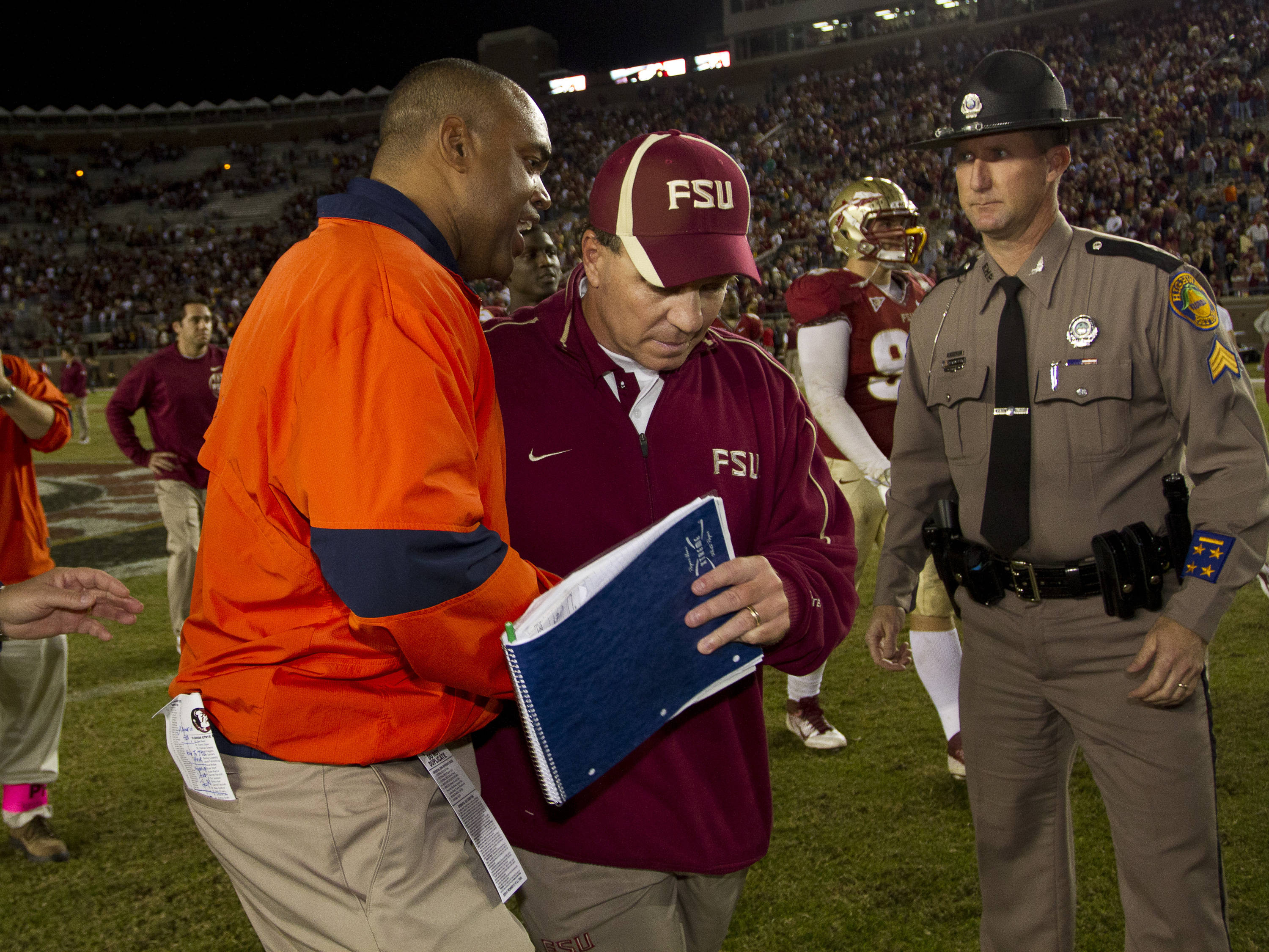 Jimbo Fisher speaks with Virginia's coach after the game against Virginia on November 29, 2011.