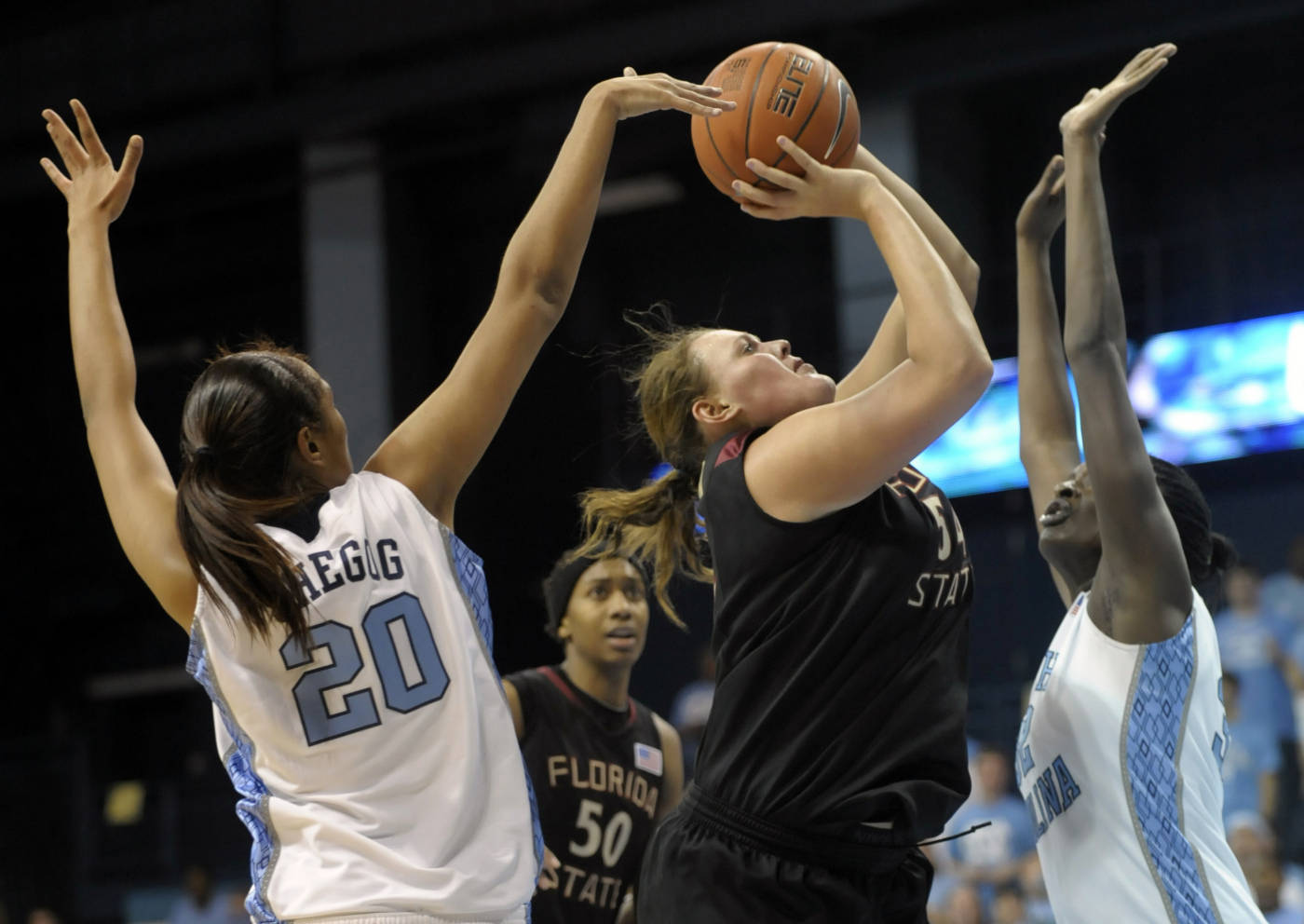 Florida State's Cierra Bravard (54) shoots over North Carolina's Chay Shegog (20) and Waltiea Rolle, right,  during the second half an NCAA college basketball game in Durham, N.C., Monday, Feb. 1, 2010. Florida State won 83-73 over North Carolina. (AP Photo/Sara D. Davis)