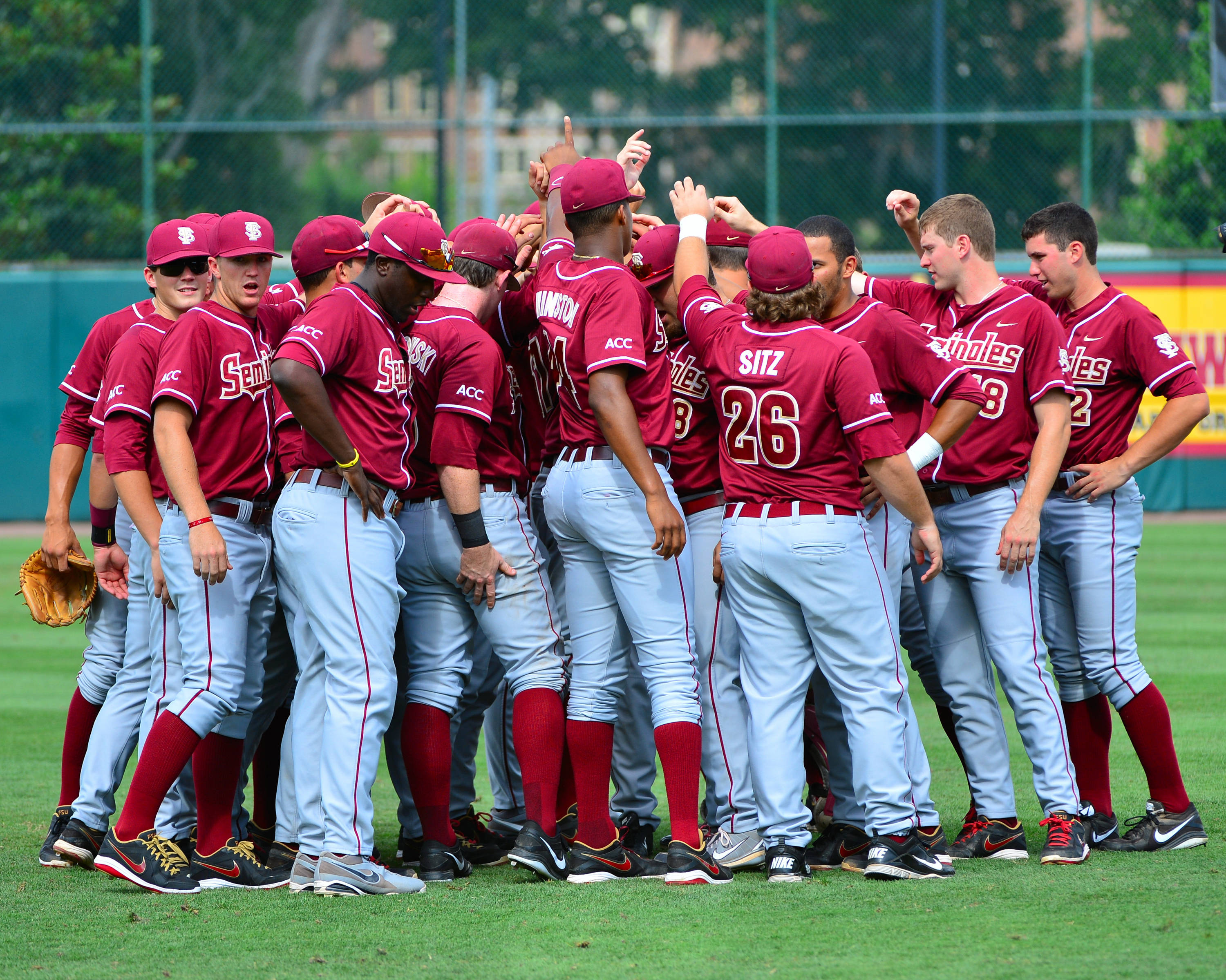 The Seminoles gather in the outfield before the start of Saturday's game vs. Troy.