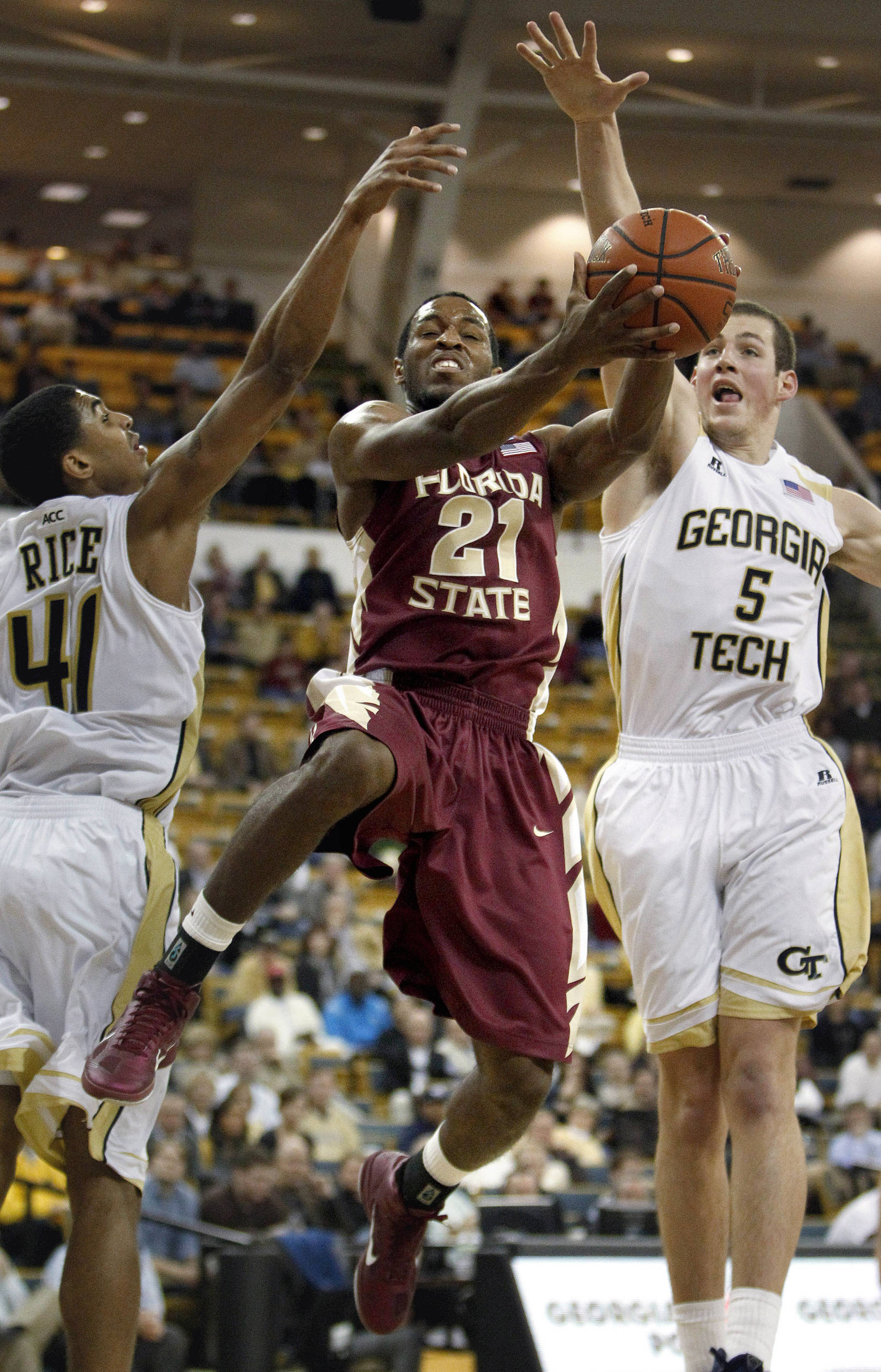 Florida State guard Michael Snaer (21) puts up a shot against Georgia Tech guard Glen Rice Jr. (41) and center Daniel Miller (5) during the second half. (AP Photo/David Goldman)