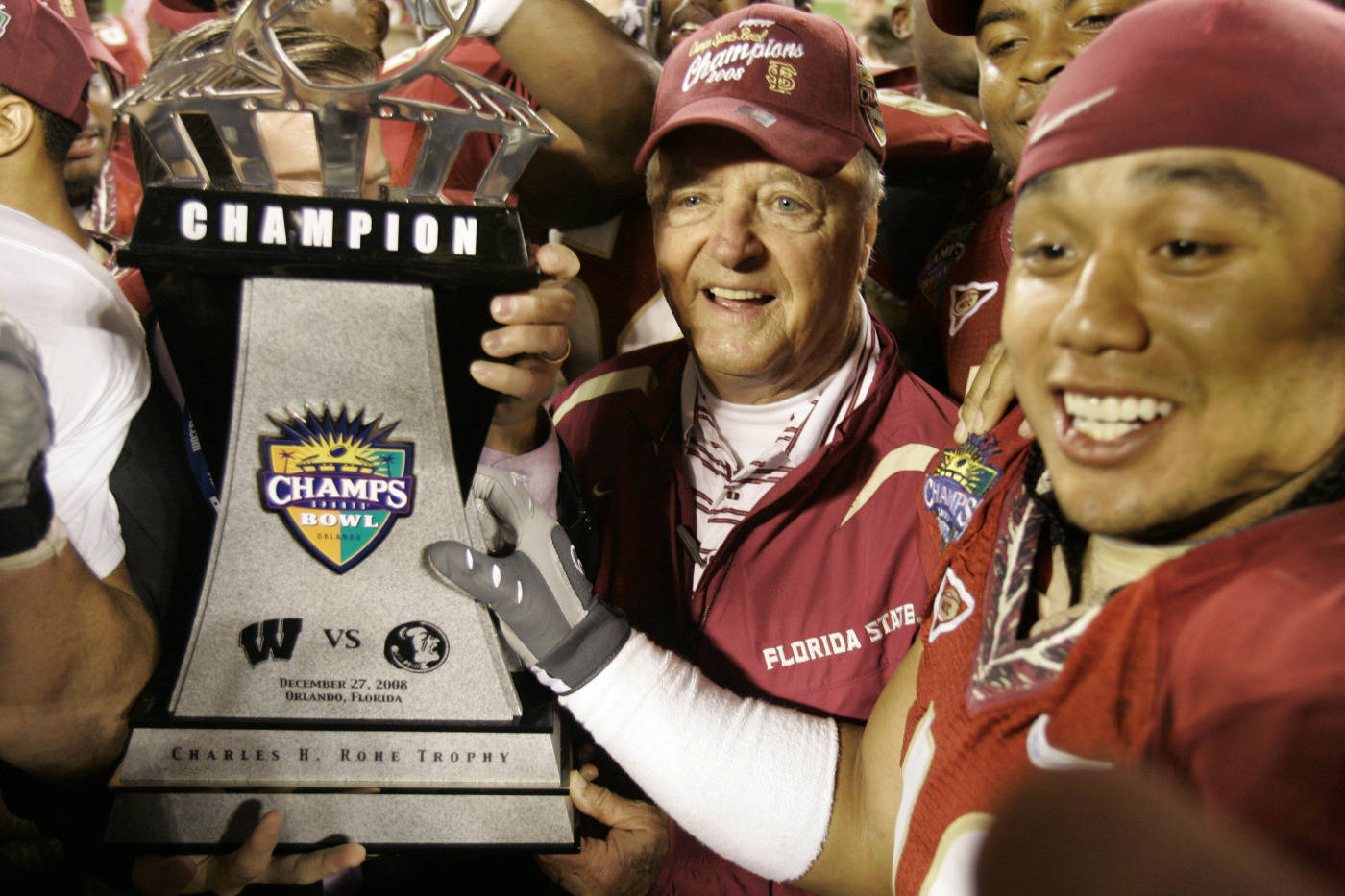 Florida State head coach Bobby Bowden, center, and defensive end Benjamin Lampkin hold the championship trophy after defeating Wisconsin 42-13 in the Champs Sports Bowl. (AP Photo/John Raoux)
