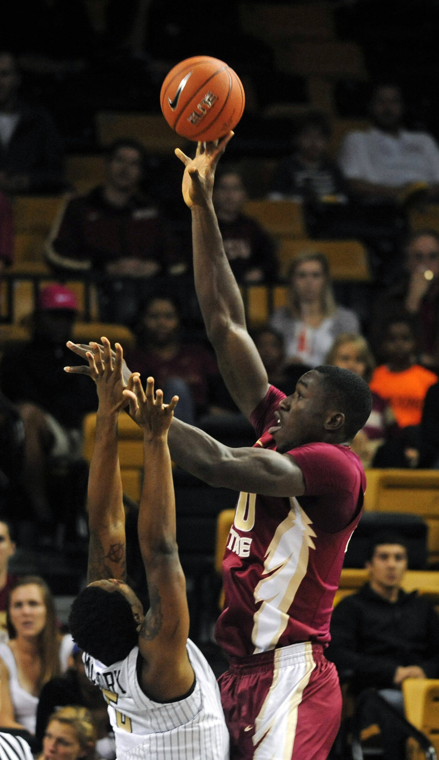 Center Michael Ojo (50) lays up a shot overtop Knights forward Eugene McCrory (5). David Manning-USA TODAY Sports