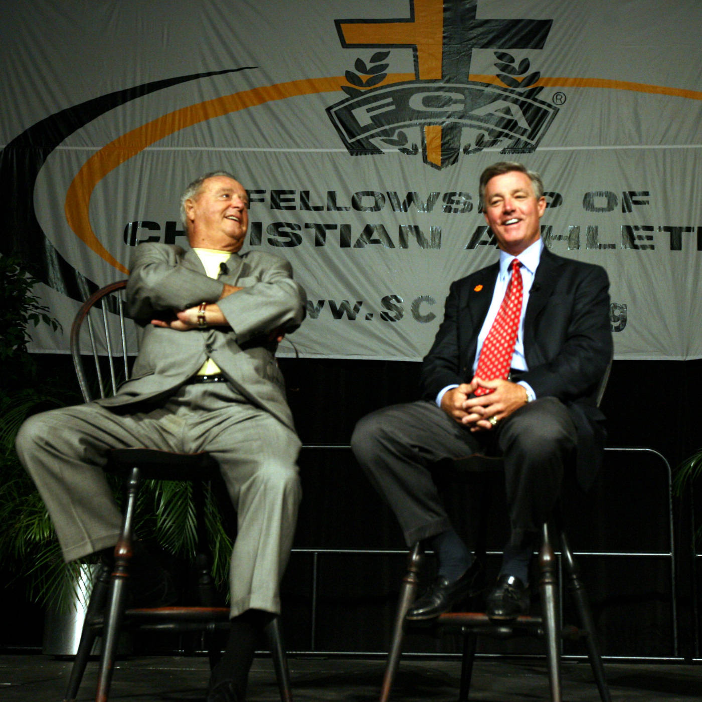 Florida State head football coach Bobby Bowden, left, and his son, Tommy, head coach at Clemson, share a laugh during their annual Fellowship of Christian Athletes Bowden Breakfast Monday, Sept. 3, 2007, at the Carolina First Center in Greenville, S.C. The FCA of Upstate South Carolina has sponsored the event each year Florida State plays at Clemson since 1999. (AP Photo/Anderson Independent-Mail, Mark Crammer)