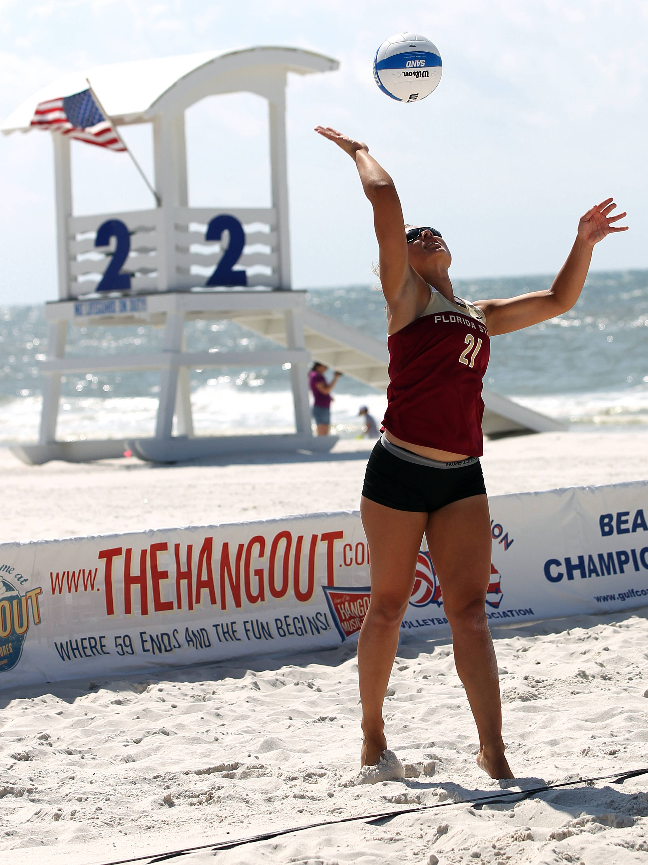 Jace Pardon serving into the wind, AVCA Collegiate Sand Volleyball National  Championships - Pairs,  Gulf Shores, Alabama, 05/05/13 . (Photo by Steve Musco)
