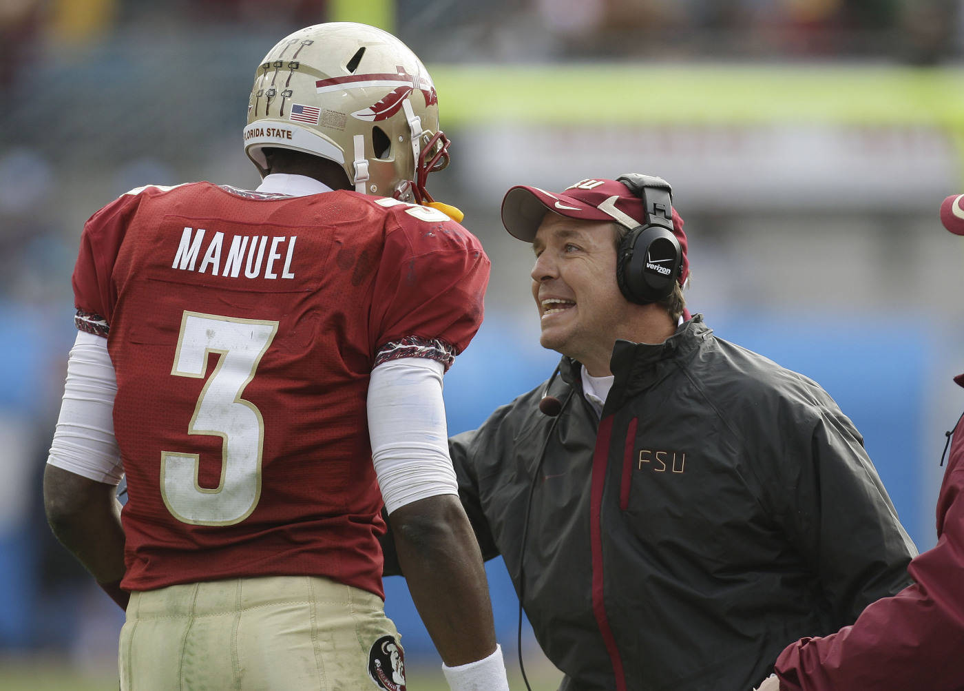 Florida State offensive coordinator Jimbo Fisher, right, talks with Florida State quarterback E.J. Manuel during the second quarter of the Gator Bowl NACAA college football game against West Virginia on Friday, Jan. 1, 2010, in Jacksonville, Fla.  .(AP Photo/Phil Coale)