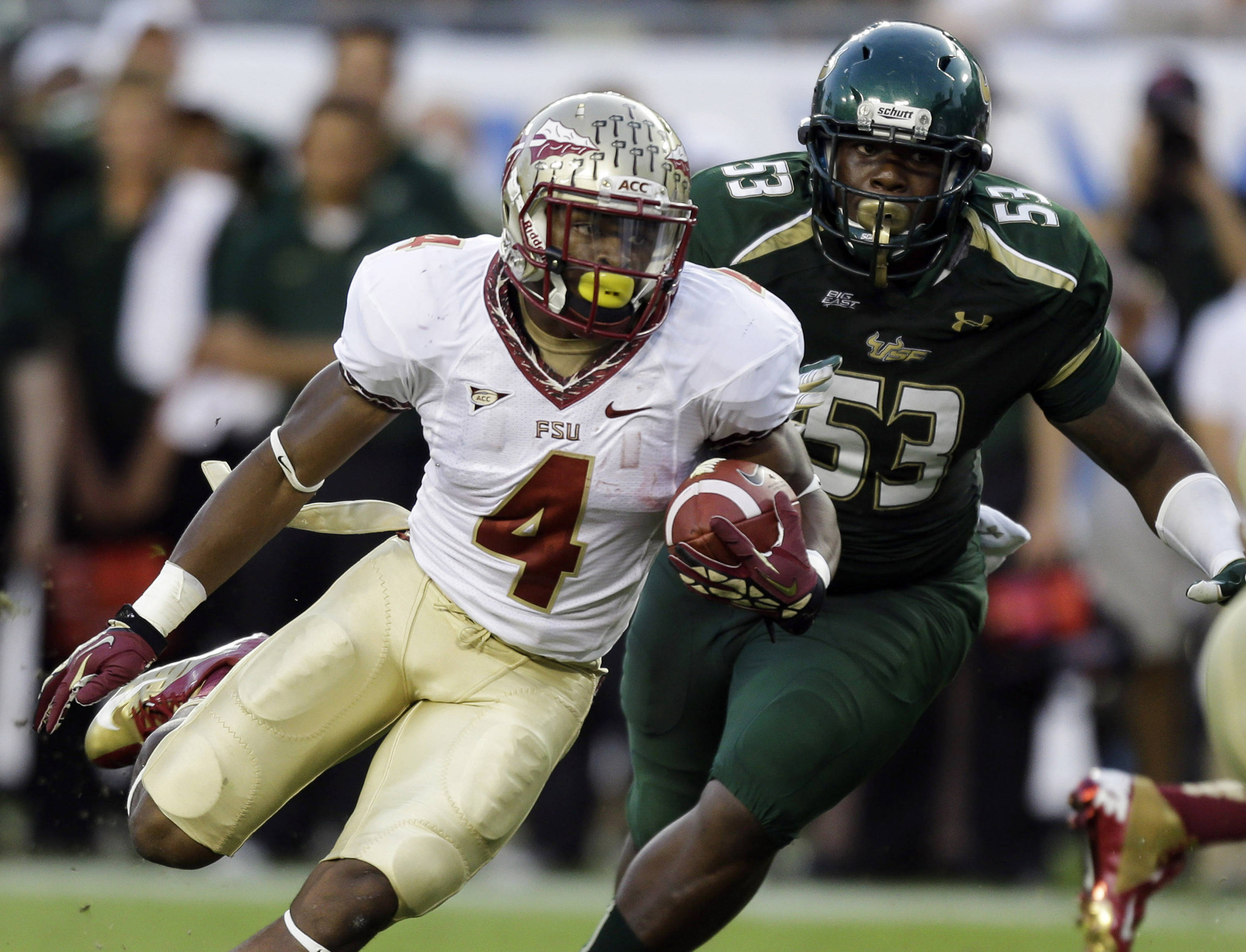 Florida State running back Chris Thompson (4) cuts in front of South Florida defensive lineman Elkino Watson (53) during the second quarter. (AP Photo/Chris O'Meara)