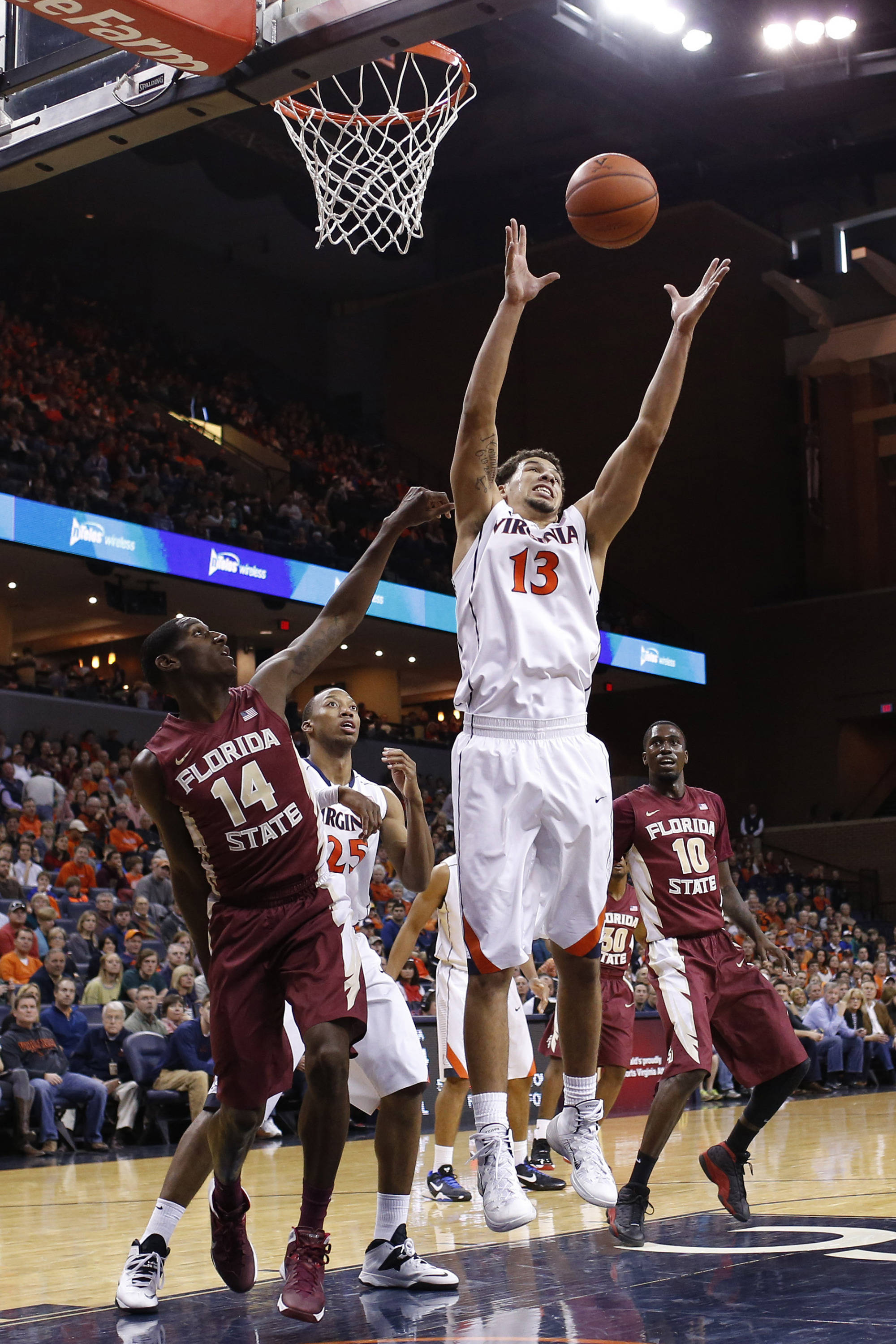 Jan 18, 2014; Charlottesville, VA, USA; Virginia Cavaliers forward Anthony Gill (13) grabs the ball in front of Florida State Seminoles forward Robert Gilchrist (14) in the first half at John Paul Jones Arena. Mandatory Credit: Geoff Burke-USA TODAY Sports