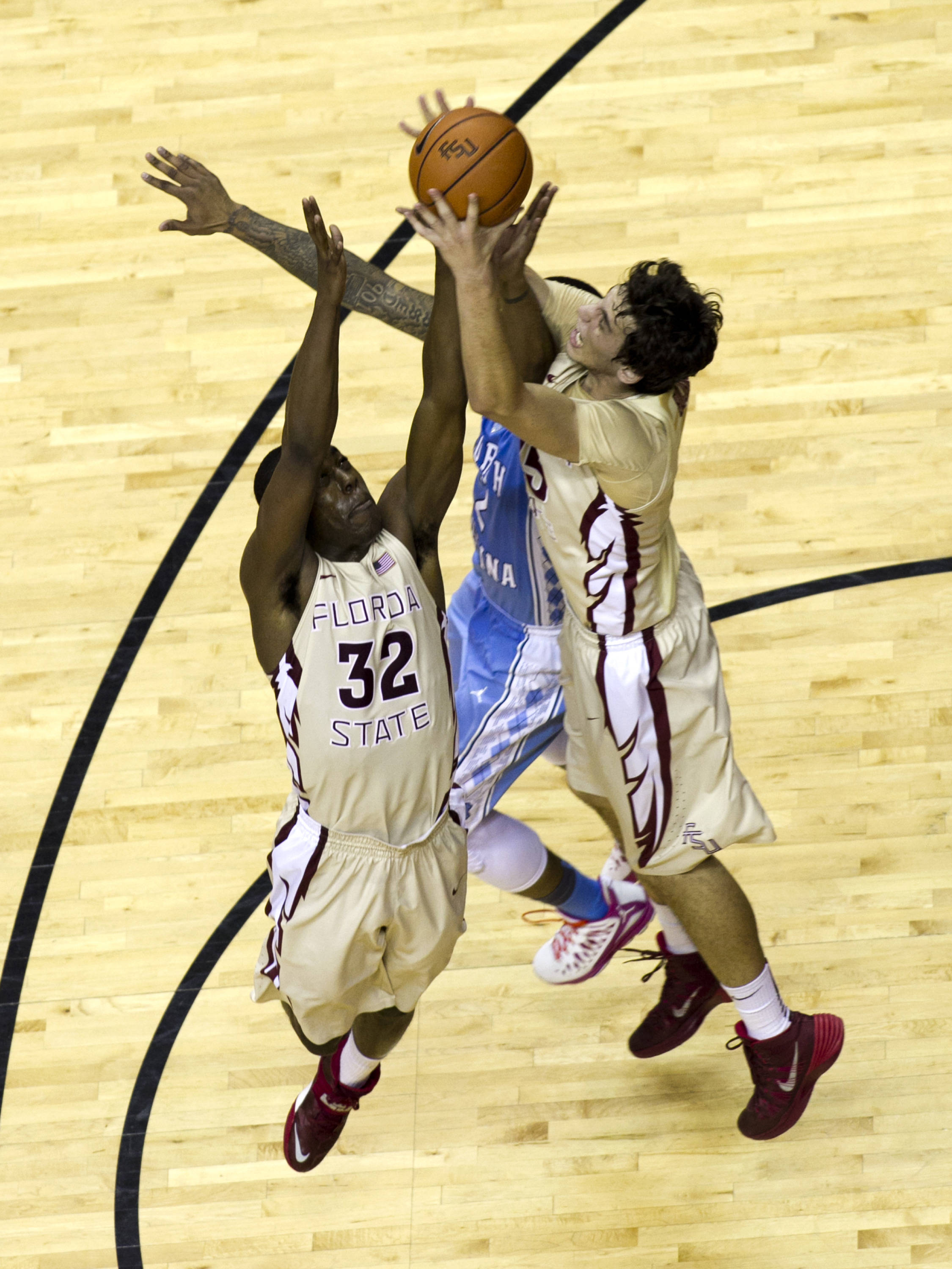 Montay Brandon (32) and Boris Bojanovsky (15) battle for a rebound, FSU vs North Carolina, 2-17-14, (Photo's by Steve Musco)