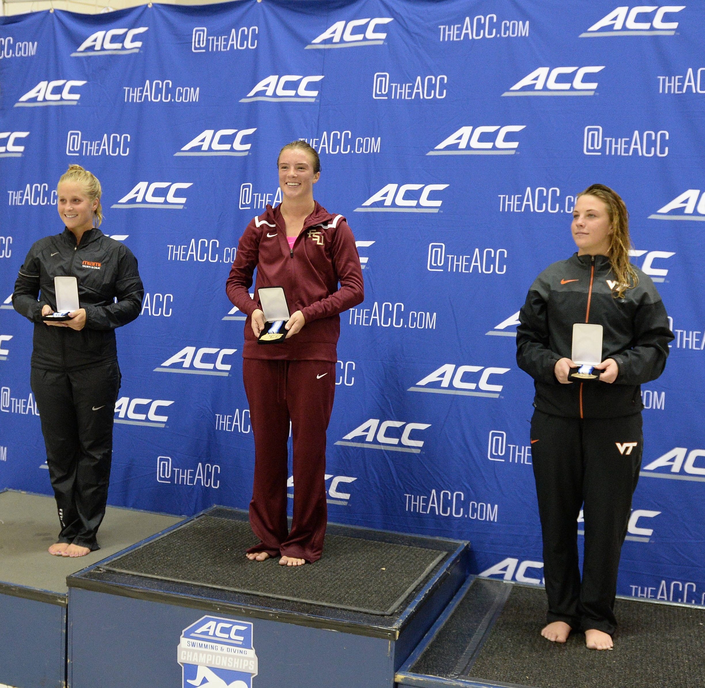 Katrina Young stands on top of the podium of 1-meter - Mitch White