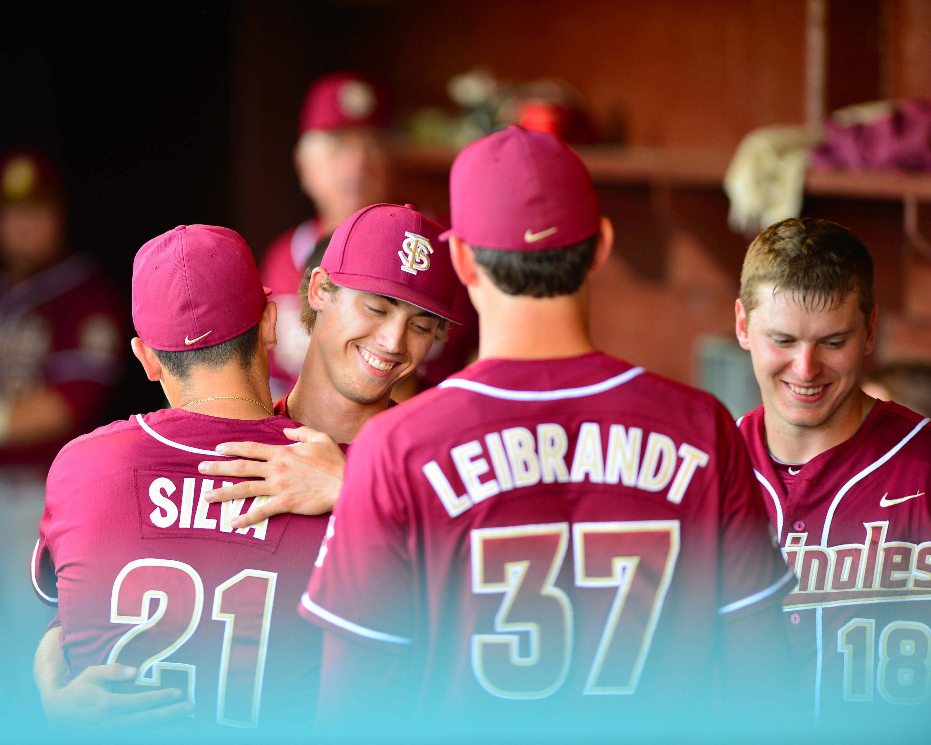 Luke Weaver is greeted in the dugout by teammates after the eighth inning.