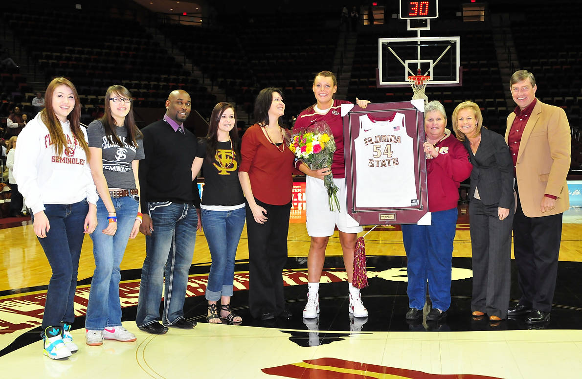 Cierra Bravard poses with her family on Senior Day