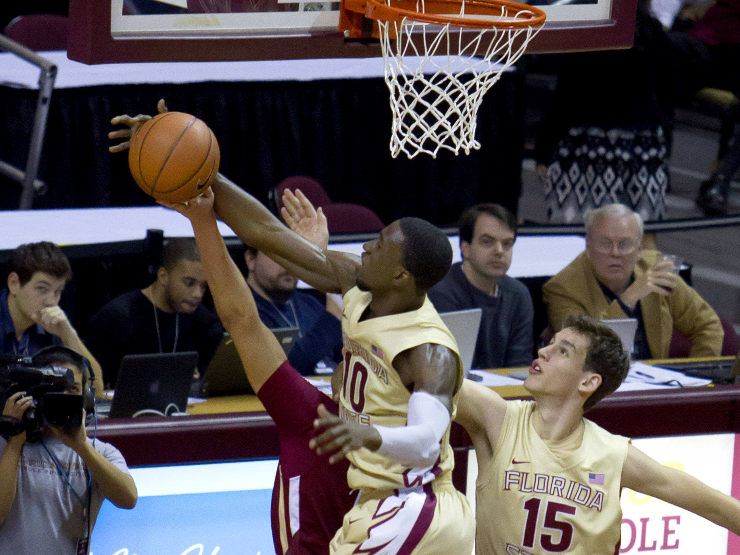 Okaro White (10) with a block, FSU vs BC, 02/16/13. (Photo by Steve Musco)