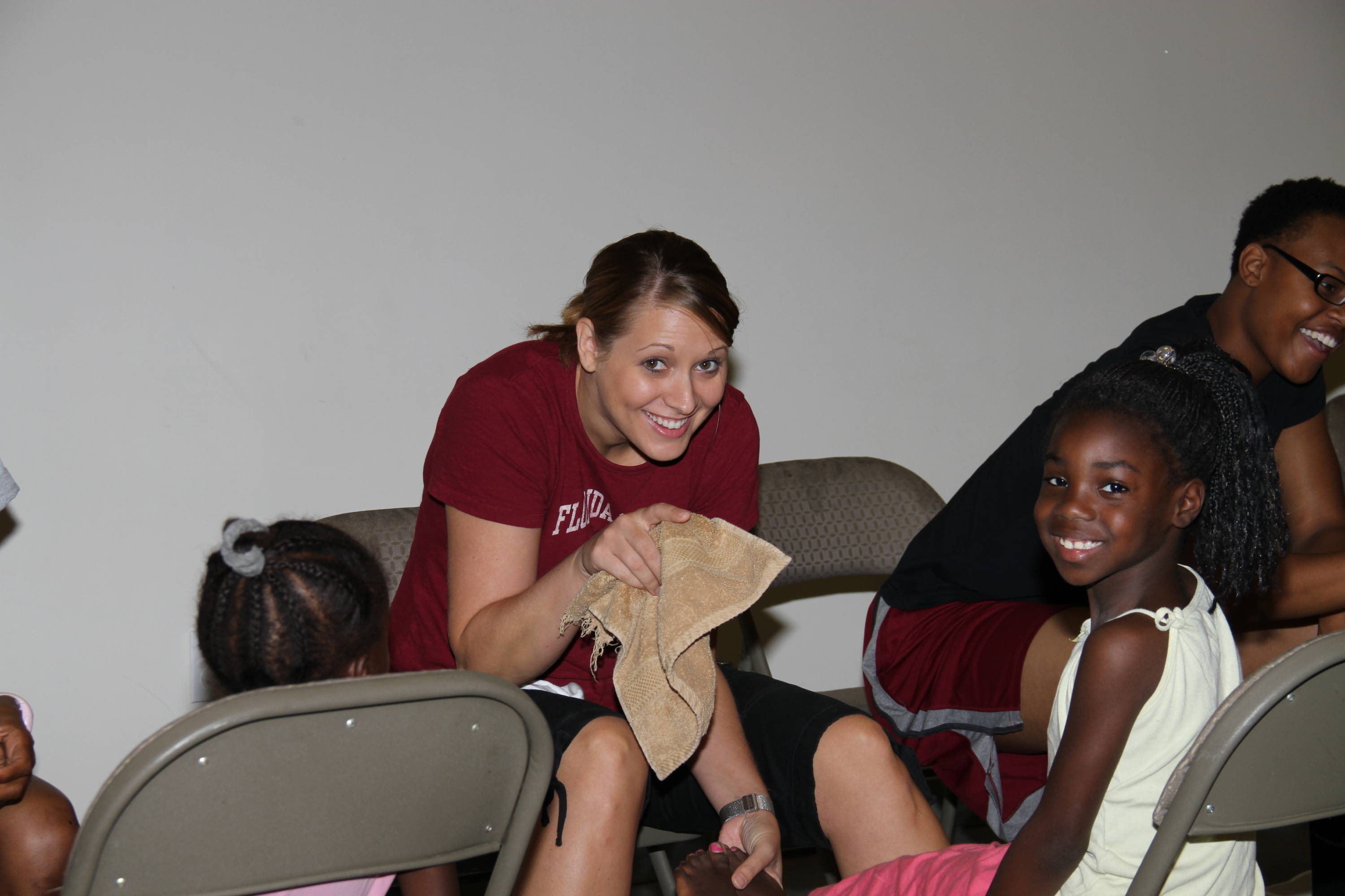 Assistant Director of Marketing Candace Friedrich takes part in the team's community service.