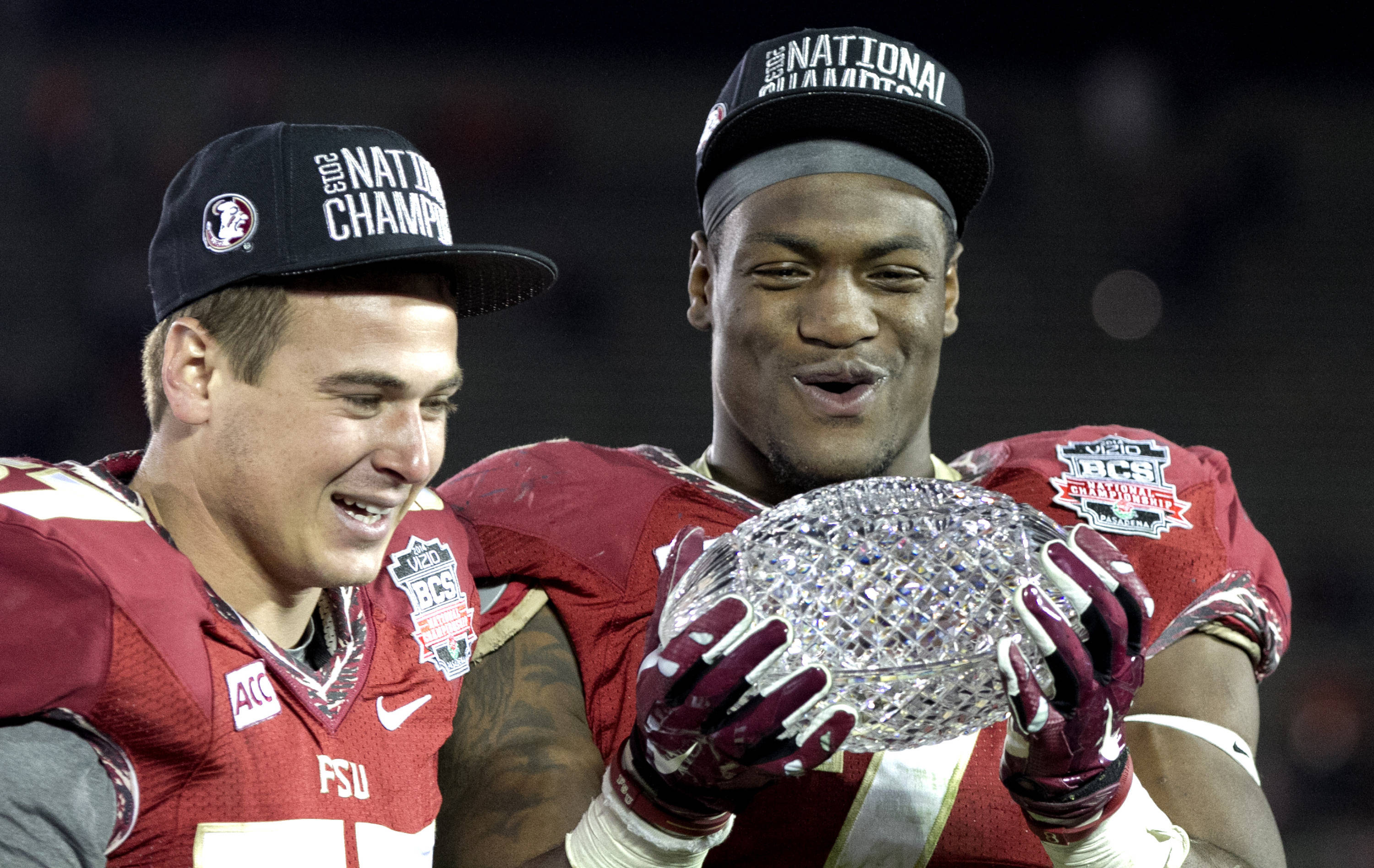 Philip Doumar (57) and Christian Jones (7) enjoying a trophy moment, BCS Championship, FSU vs Auburn, Rose Bowl, Pasadena, CA,  1-06-14,  (Photo by Steve Musco)
