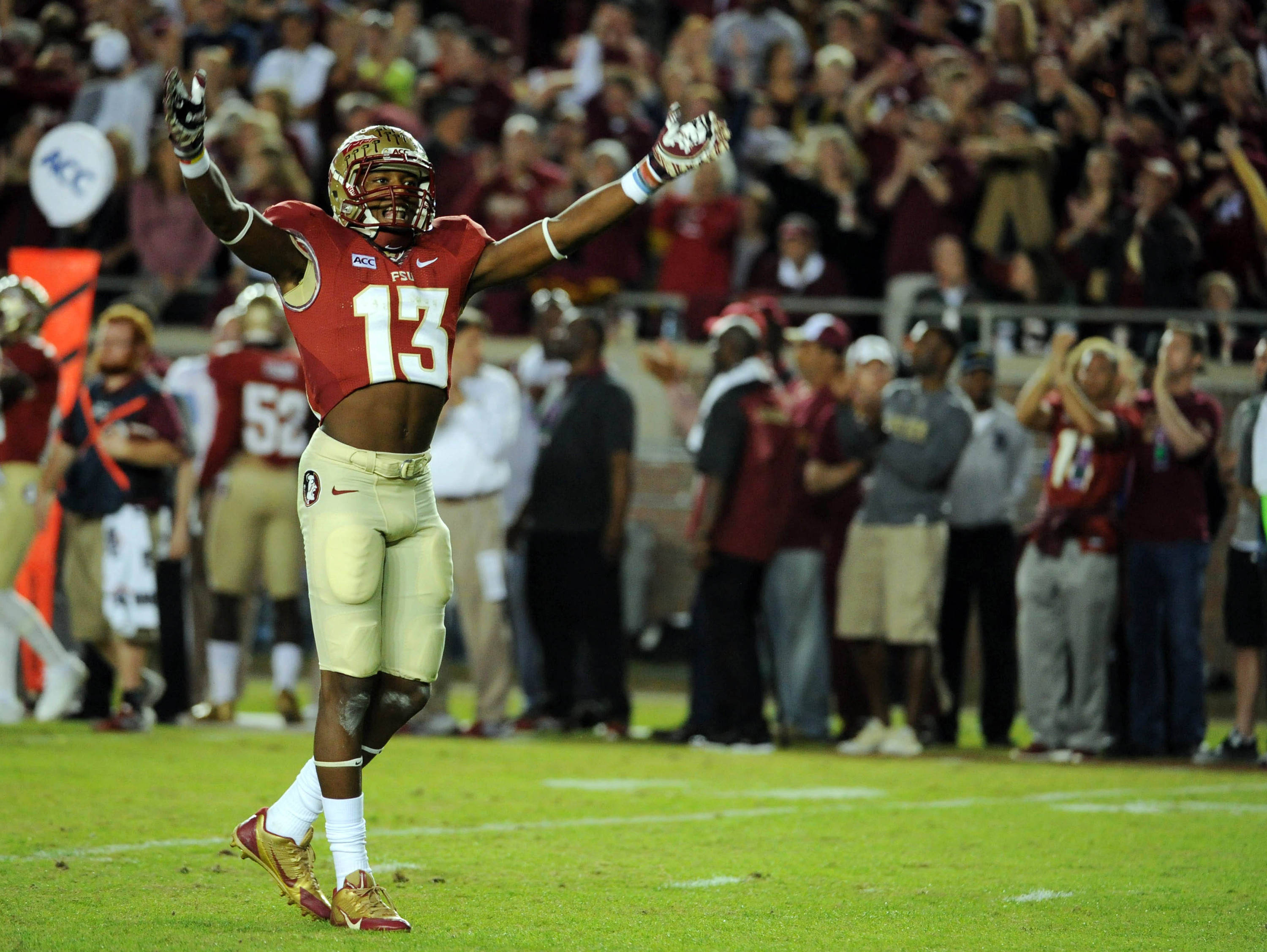 Florida State Seminoles defensive back Jalen Ramsey (13) celebrates after a defensive stop during the game against the Miami Hurricanes at Doak Campbell Stadium. Mandatory Credit: Melina Vastola-USA TODAY Sports