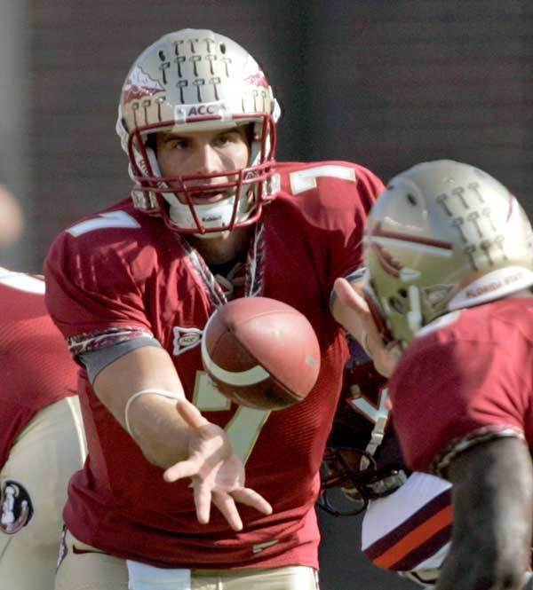 Florida State quarterback Christian Ponder, left, pitches to running back Antone Smith during the second quarter