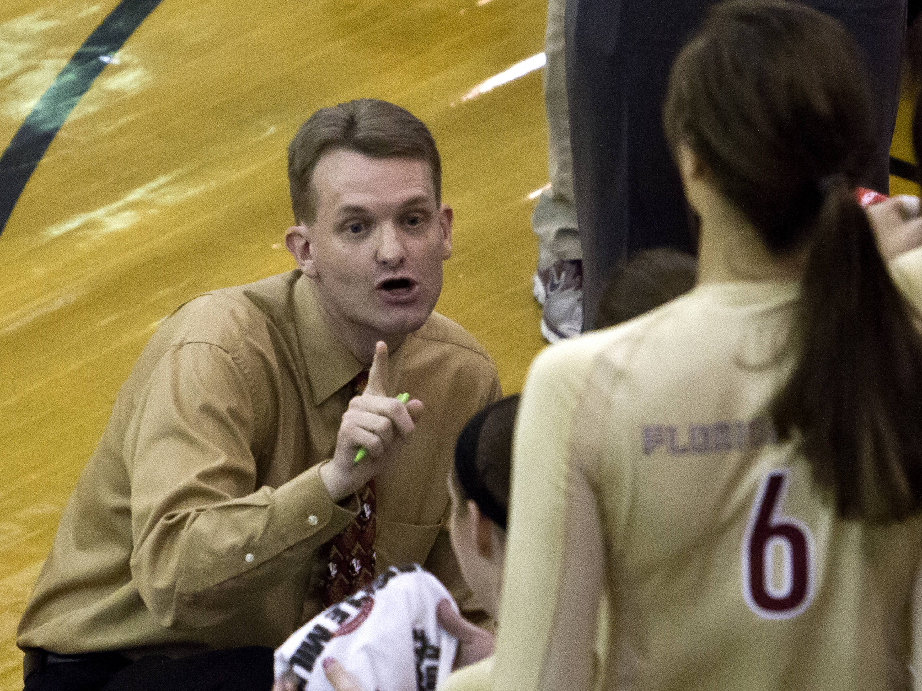 Head Coach Chris Poole with some first set instructions, FSU vs NC, 10/05/12 (Photo by Steve Musco)