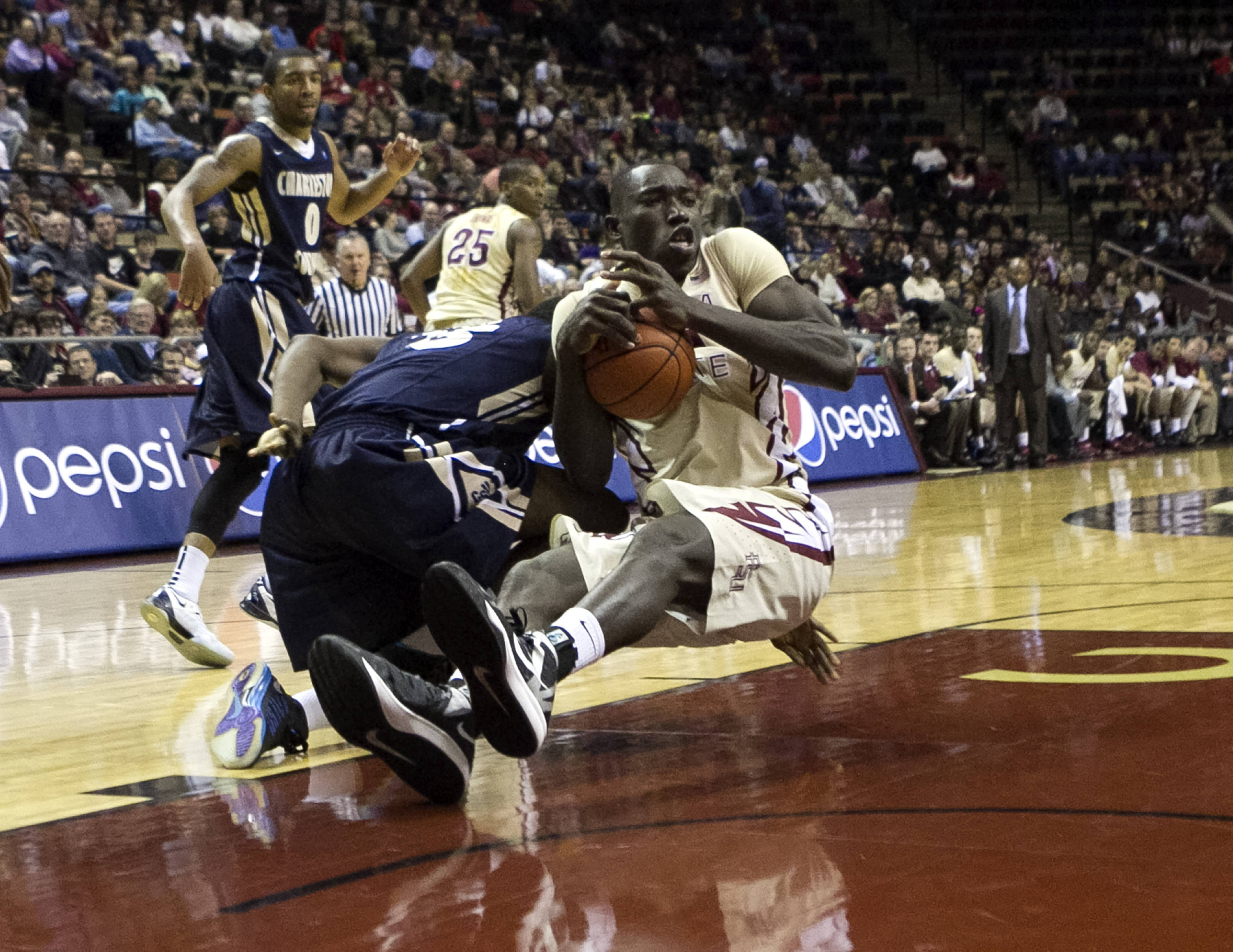 Michael Ojo (50) on the floor fighting for a loose ball, FSU vs Charleston Southern, 12-30-13,  (Photo by Steve Musco)