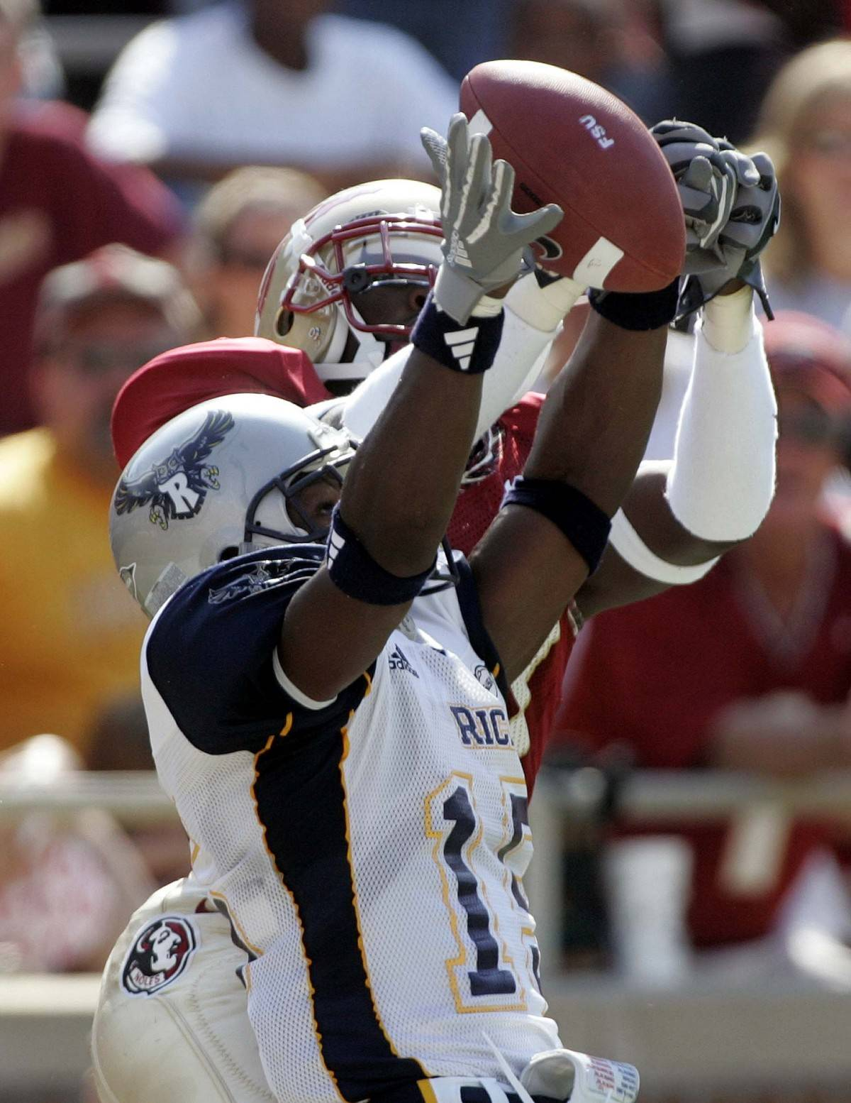Rice defensive back Brandon King, foreground, knocks the ball away from Florida State receiver Greg Carr during the first quarter of an NCAA football game, Saturday, Sept. 23, 2006, in Tallahassee, Fla.(AP Photo/Phil Coale)