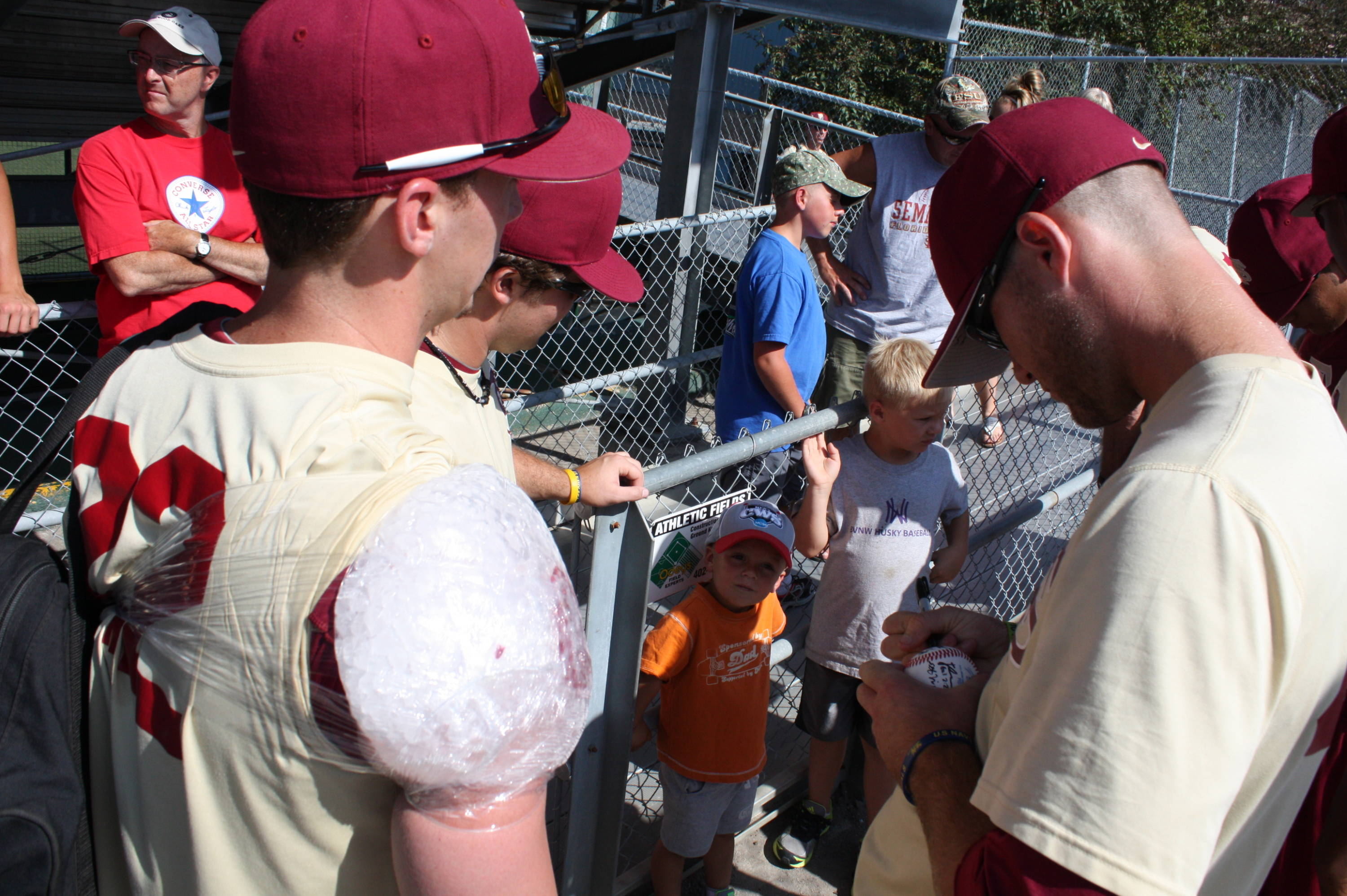 The Seminoles signing autographs after practice