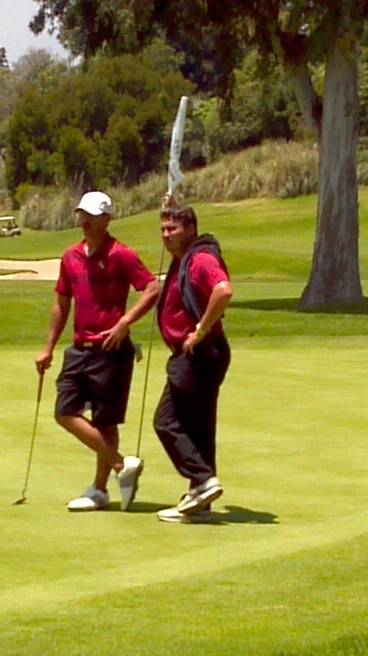 Brooks Koepka and assistant coach Robert Duck after a birdie putt on hole No. 17 in the first round of the 2012 NCAA Division I Men's Golf Championships.
