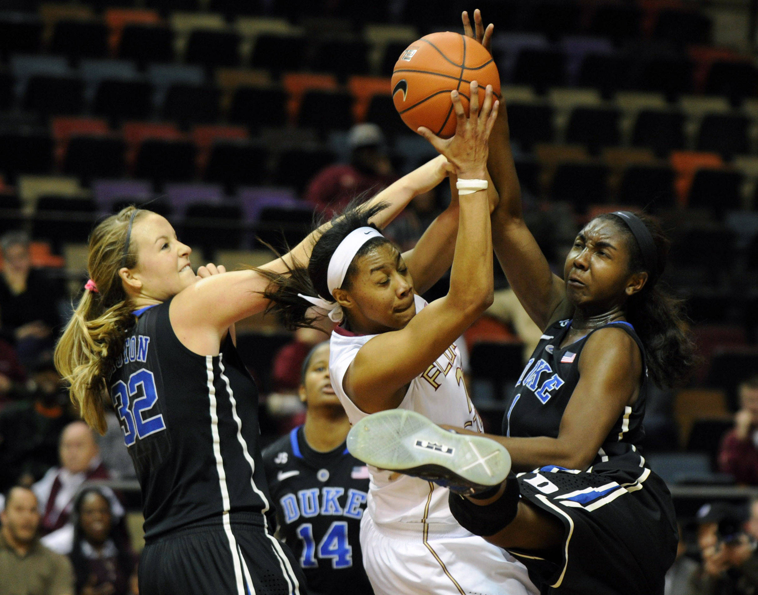 Jan 23, 2014; Tallahassee, FL, USA; Duke Blue Devils center Elizabeth Williams (1) and guard Tricia Liston (32) pressure Florida State Seminoles forward Ivey Slaughter (23) during the second half of the game at the Donald L. Tucker Center (Tallahassee). Mandatory Credit: Melina Vastola-USA TODAY Sports