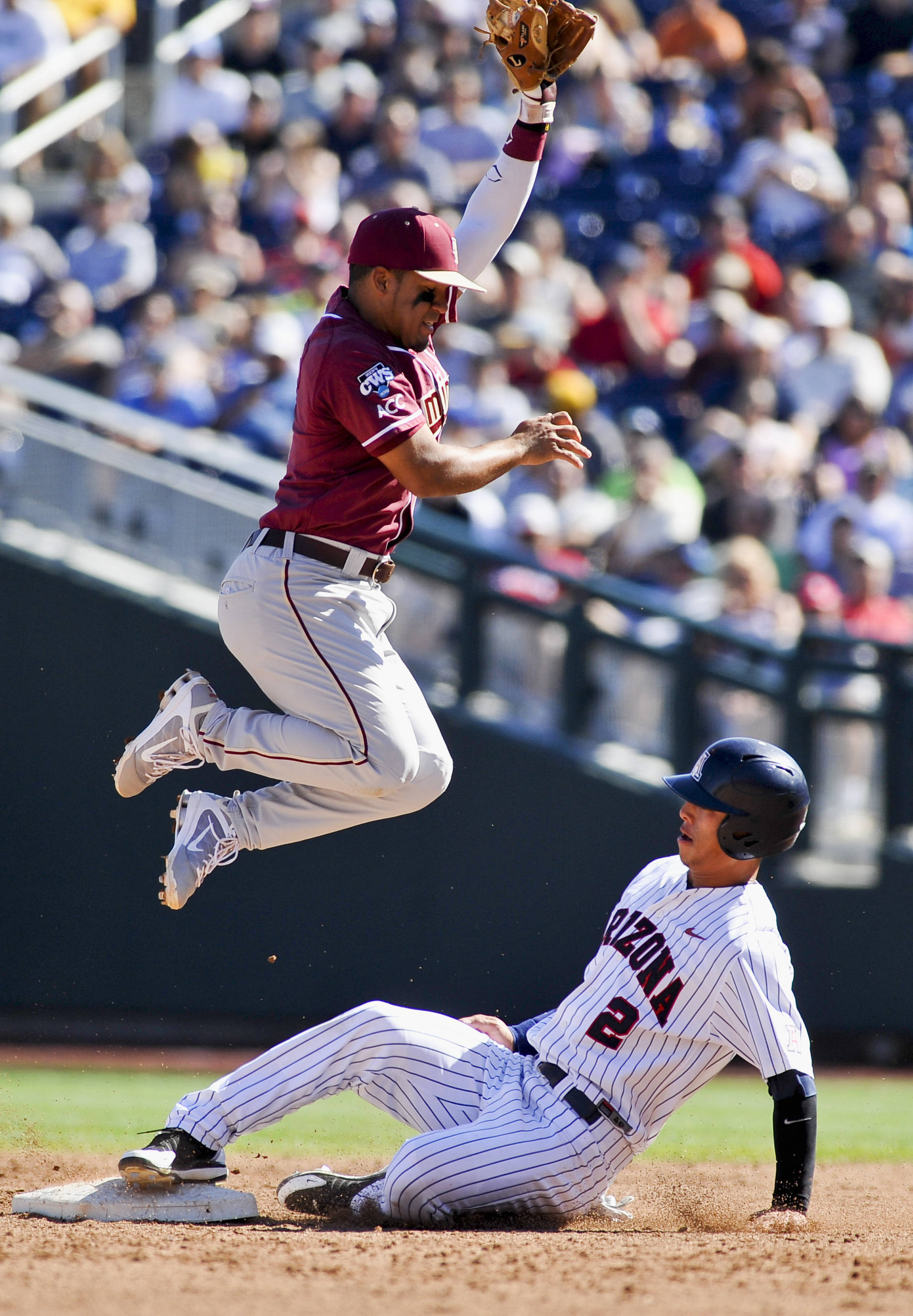 Arizona's Robert Refsnyder (2) steals second base as Florida State second baseman Devon Travis leaps for the ball during the second inning. (AP Photo/Eric Francis)