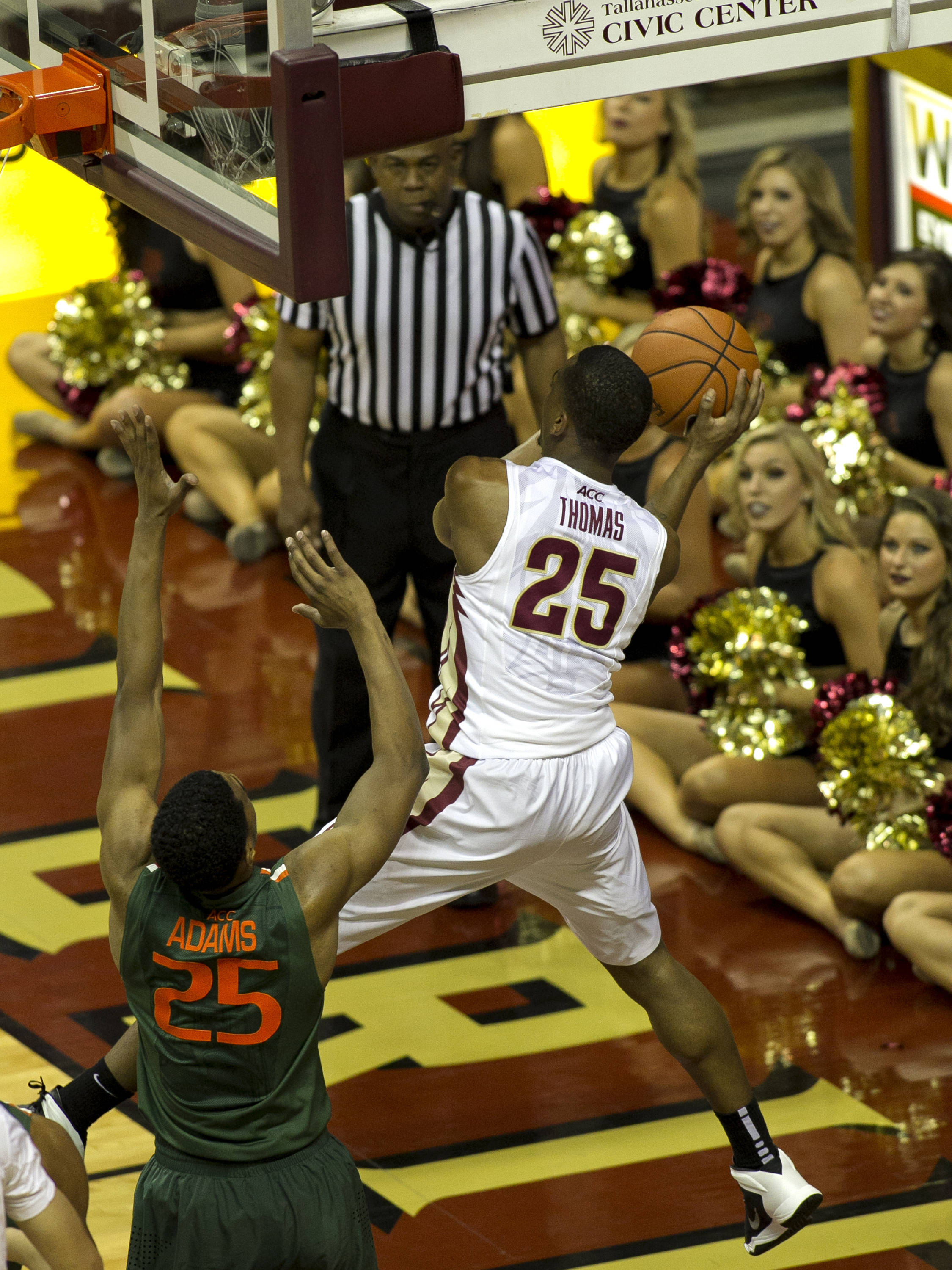 Aaron Thomas (25) goes deep under the basket for a pass, FSU vs Miami, 2-10-14, (Photo's by Steve Musco)