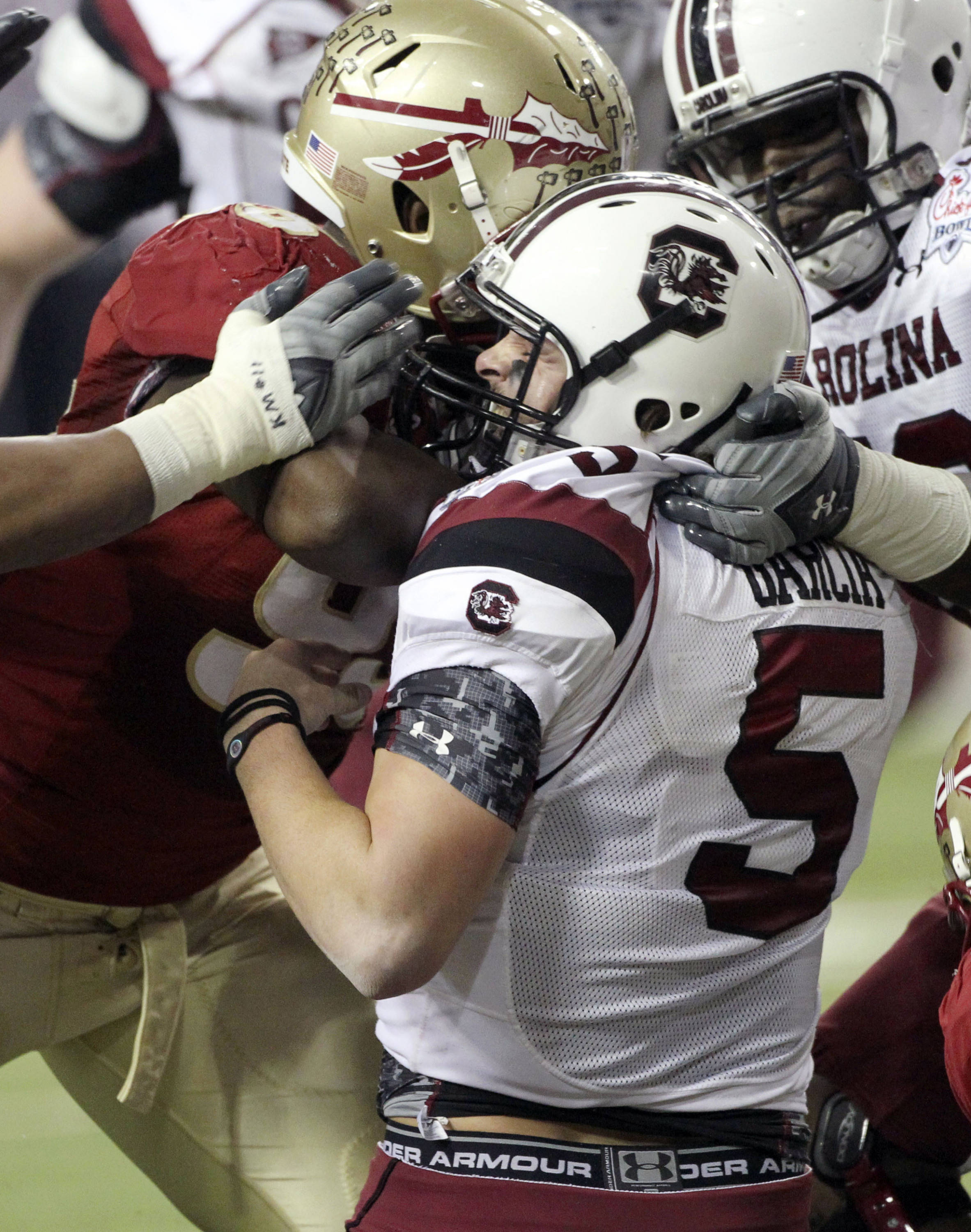 South Carolina quarterback Stephen Garcia (5) is brought down by Florida State defensive tackle Everett Dawkins (93) in the first quarter of the Chick-fil-A Bowl NCAA college football game on Friday, Dec. 31, 2010, in Atlanta. (AP Photo/John Bazemore)