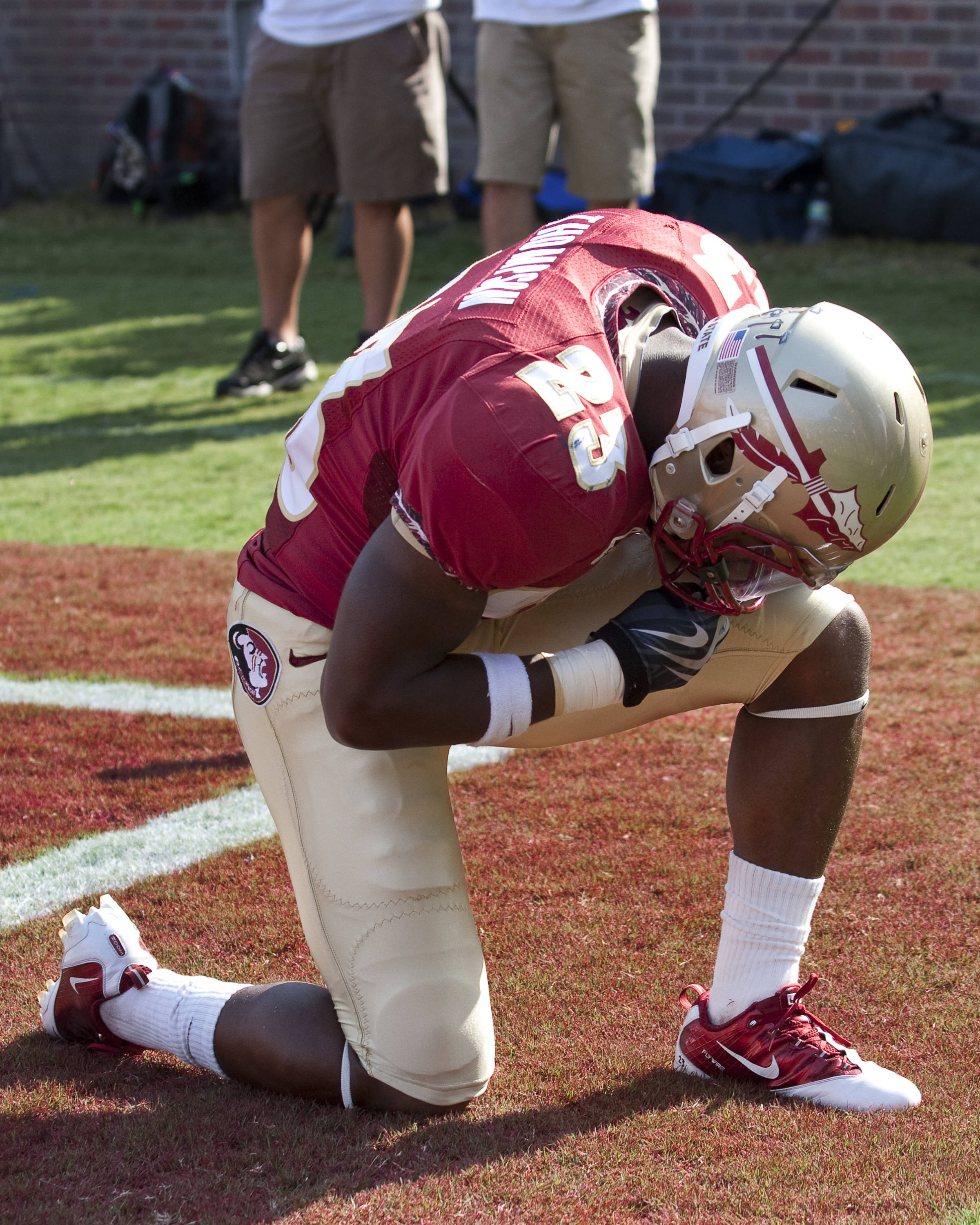 Chris Thompson (23) pauses after scoring the first touchdown of the game against BYU.