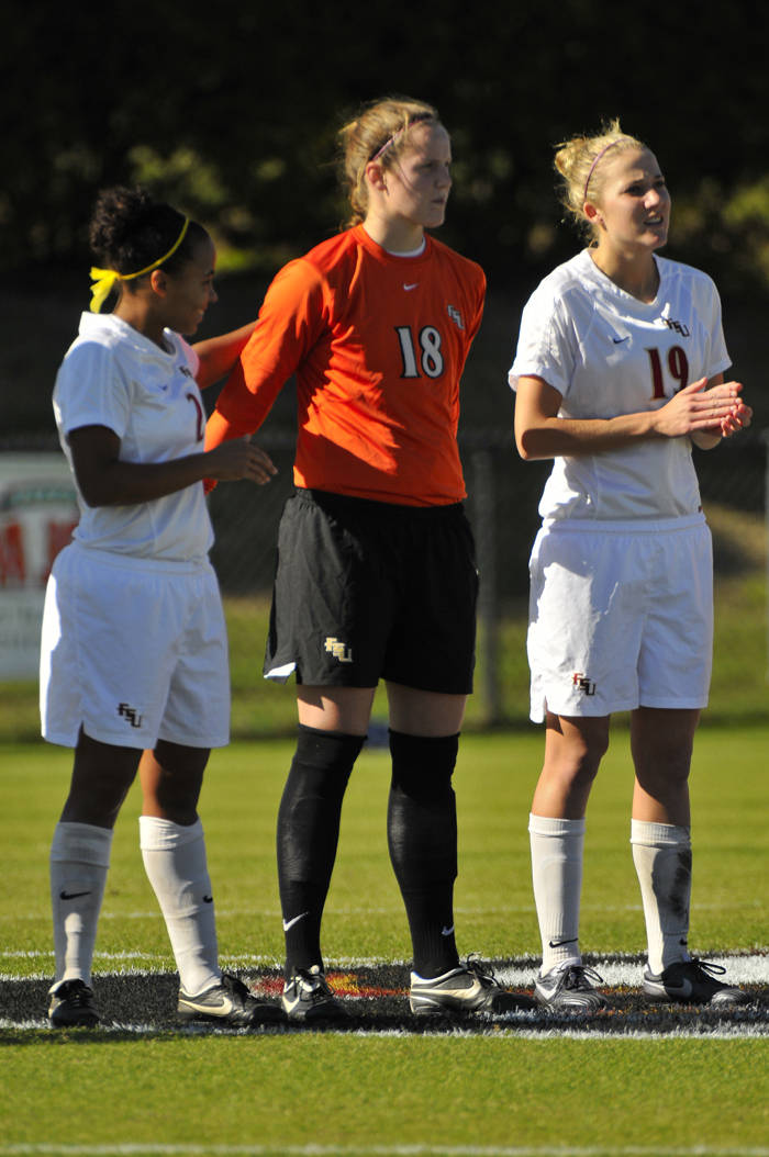Ines Jaurena, Erin McNulty and Becky Edwards during pregame introductions.