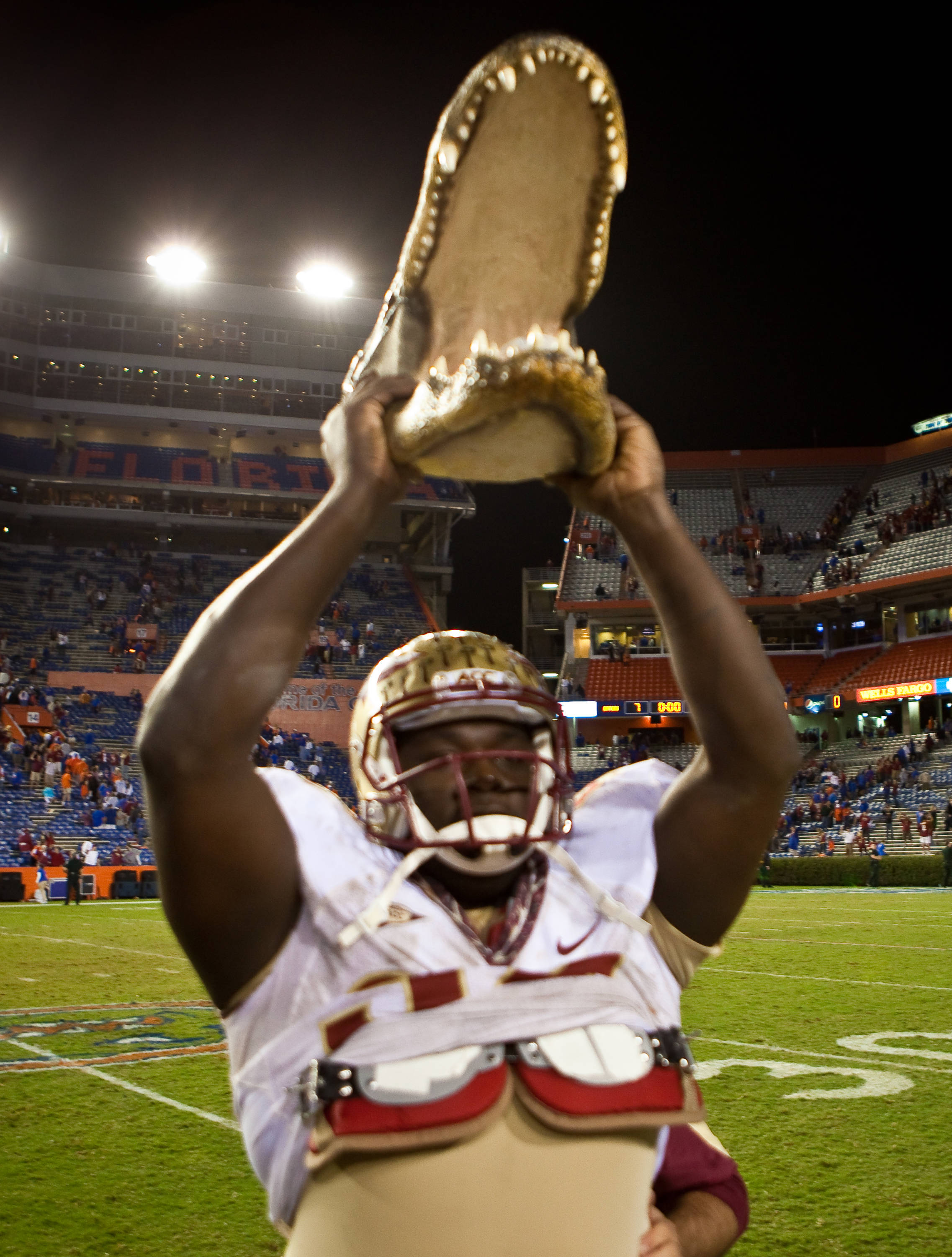 Anthony McCloud (92) holds the Gator head high