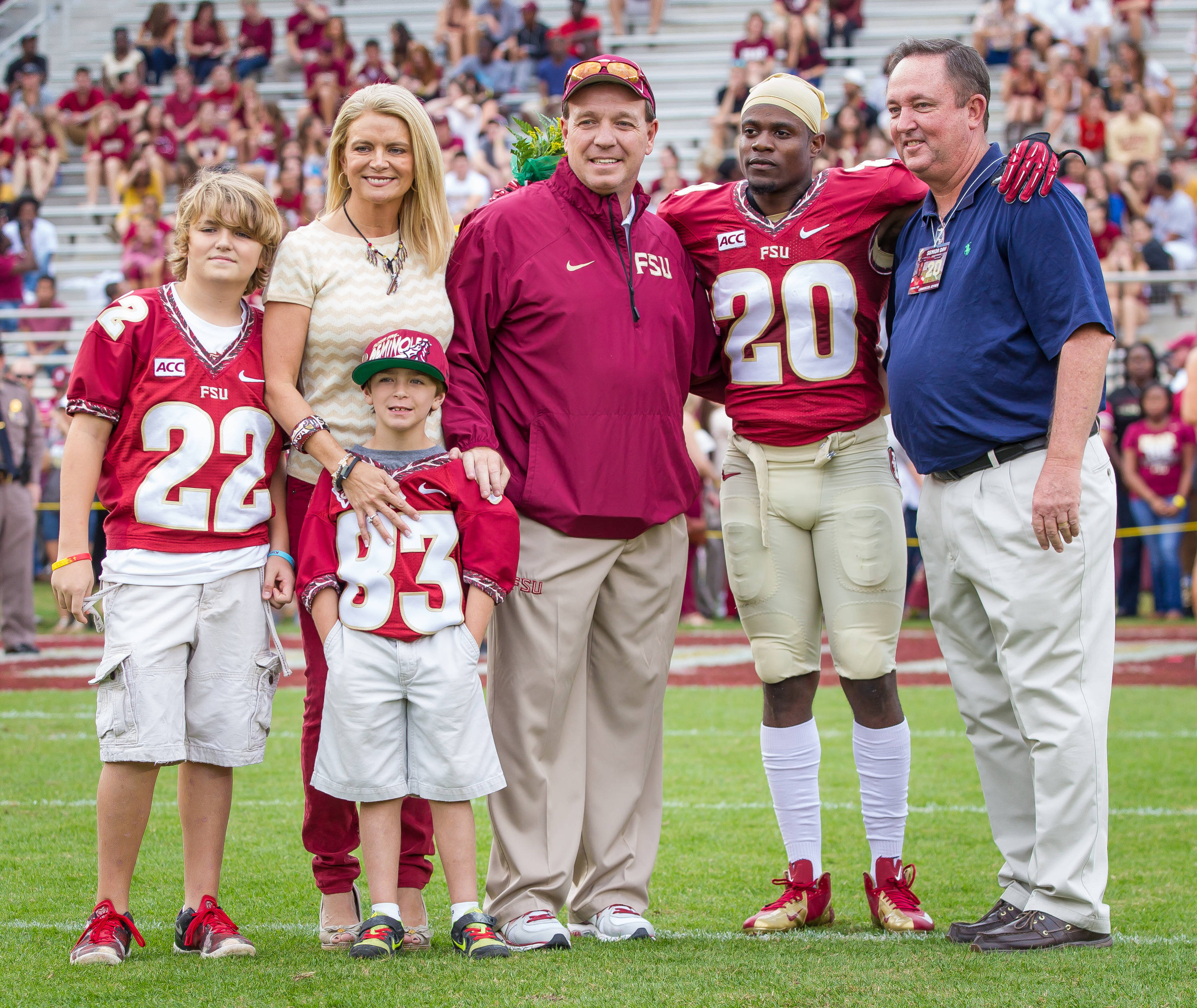 Lamarcus Joyner (20) is recognized during senior day festivities by Jimbo Fisher and family.