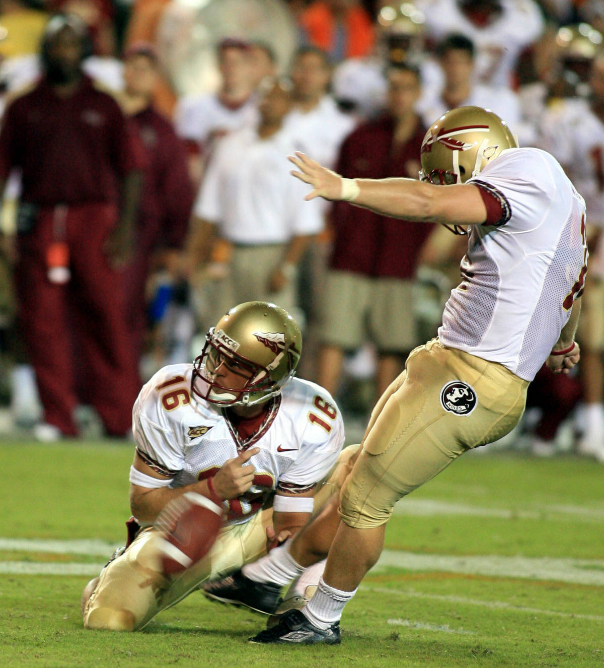 Florida State's Gary Cismesia, right, kicks a 33-yard field goal with 8:06 left in the fourth quarter of football against Miami as Brent Moody holds the ball Monday, Sept. 4, 2006 at the Orange Bowl in Miami. The 11th-ranked Seminoles defeated the No. 12 Hurricanes 13-10. (AP Photo/Luis M. Alvarez)