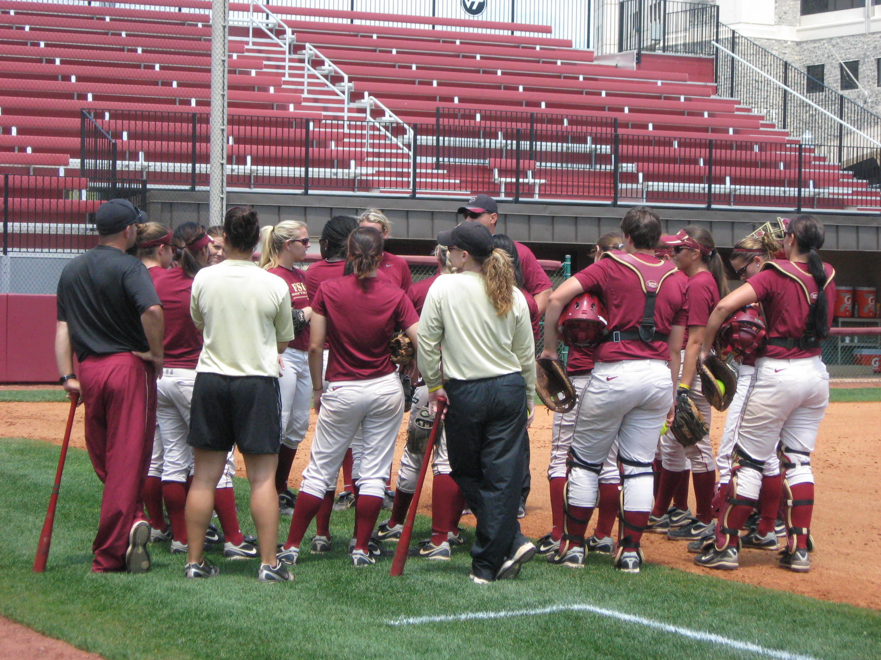 The team gathers before practice starts on Thursday at Tech Softball Park.